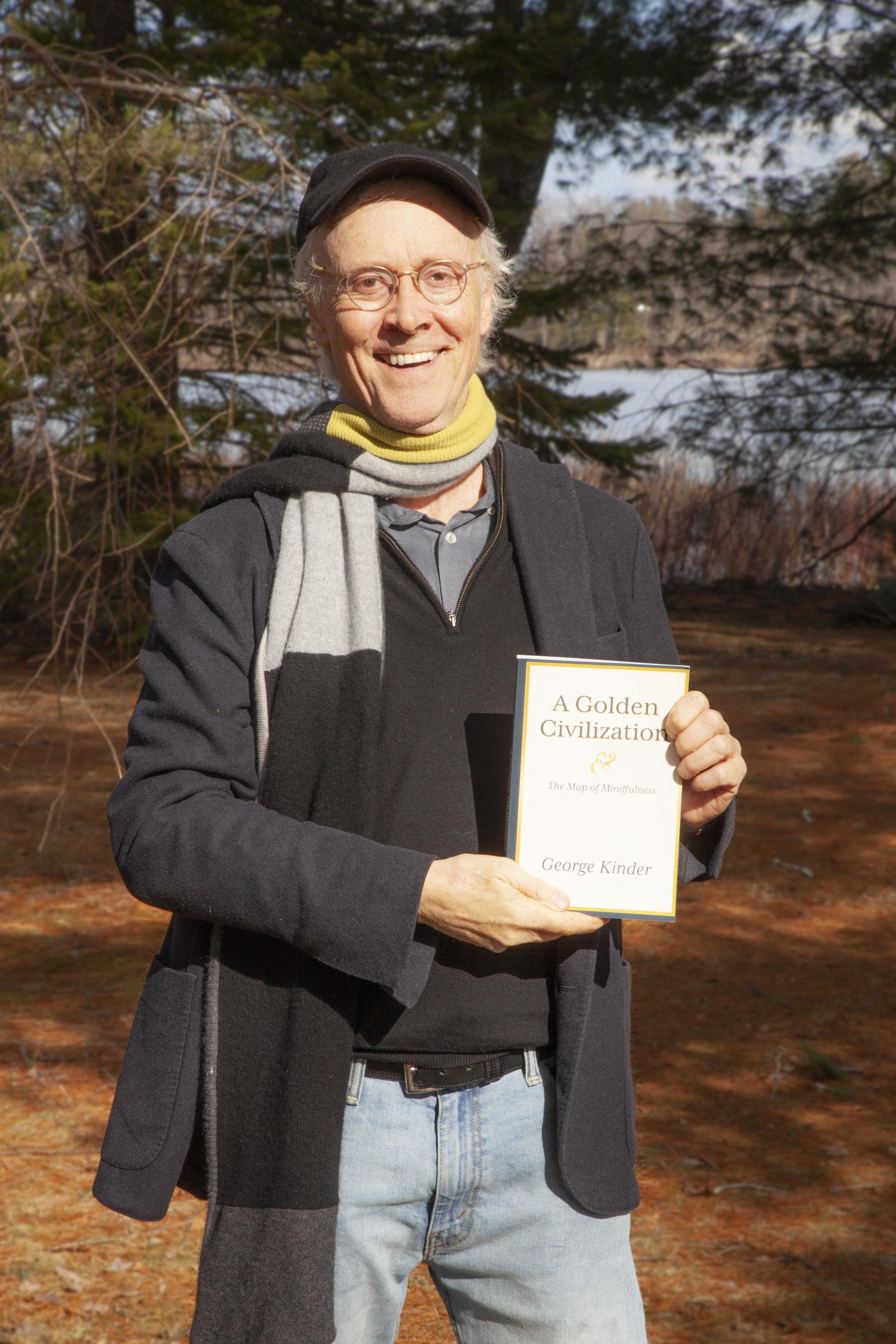 George_Holding_Book.jpg