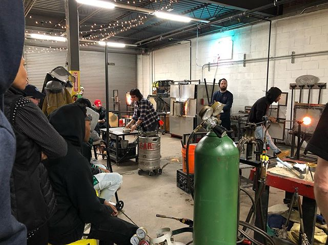Trevelli demoing for our new participants. #projectfire #youthartists #glassblowing #chicago