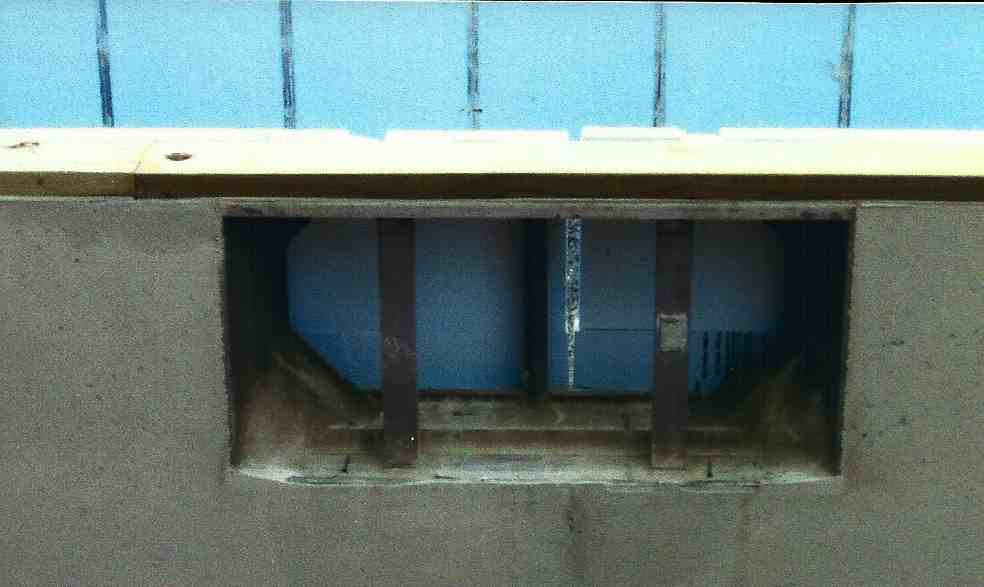 window frame out concrete foundation.jpg