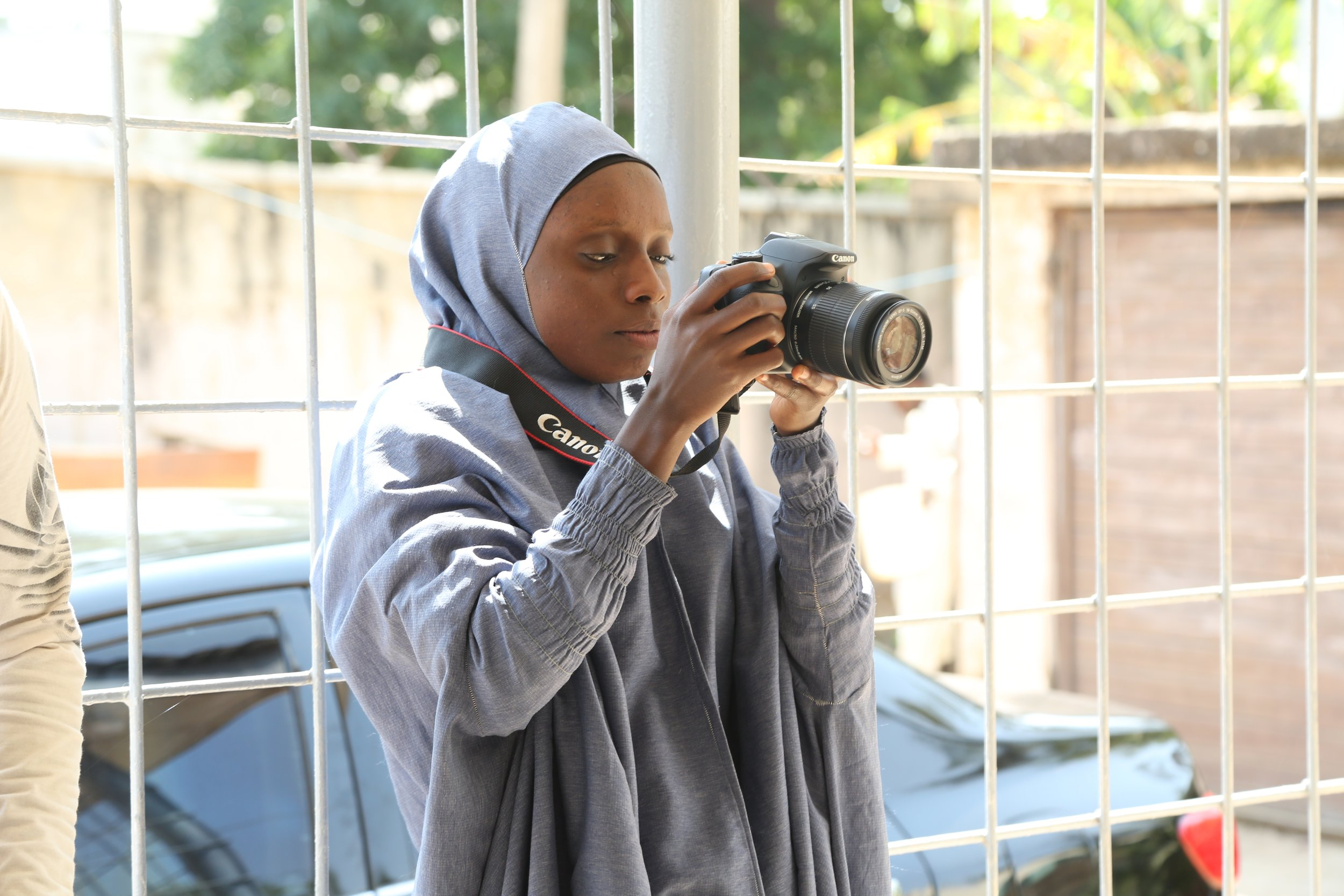 A participant in the Girls Campaign for Quality Education learning photography.
