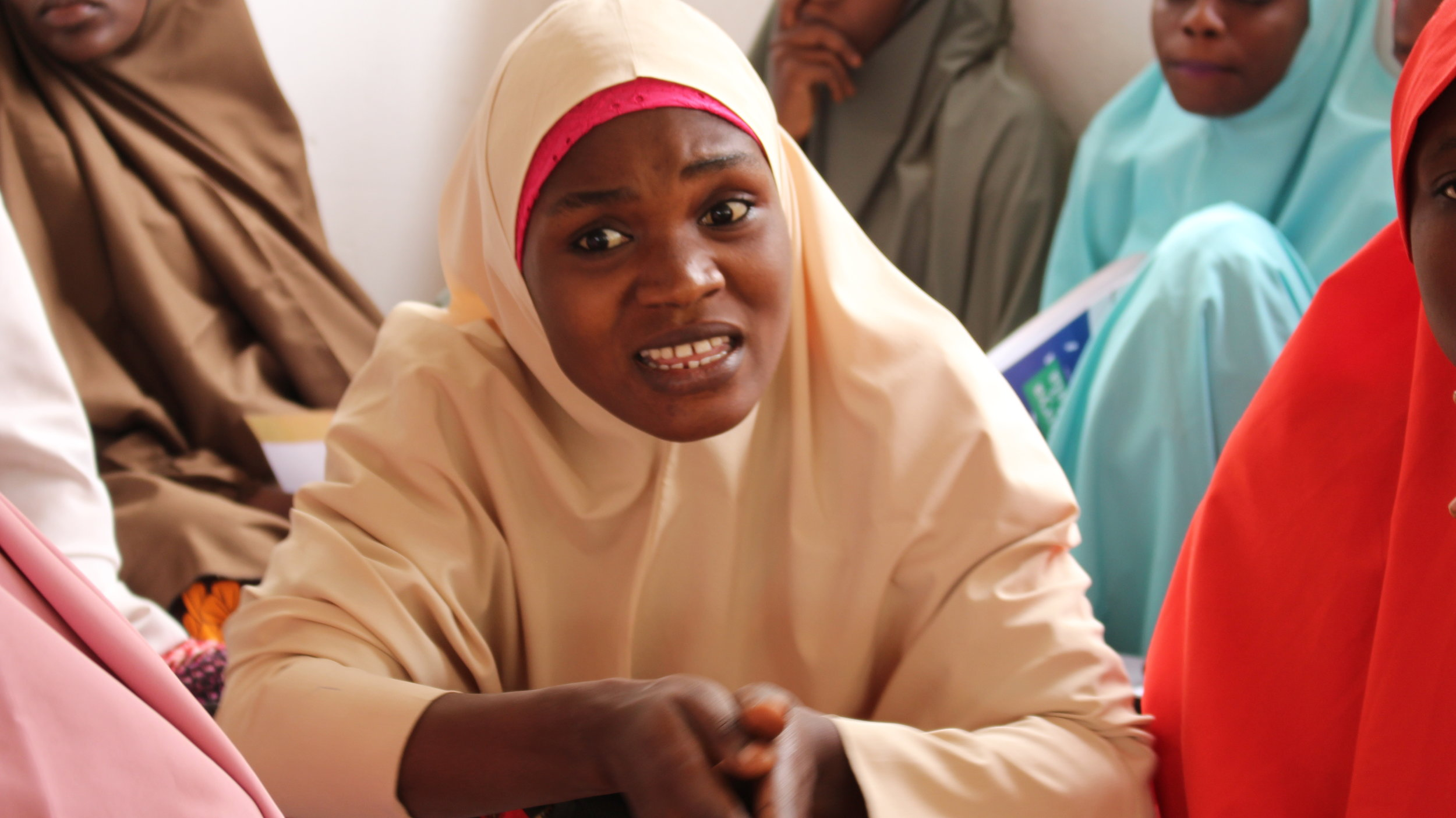 A CGE intern (former safe space) during a girls education advocacy visit to the Ministry of Education.