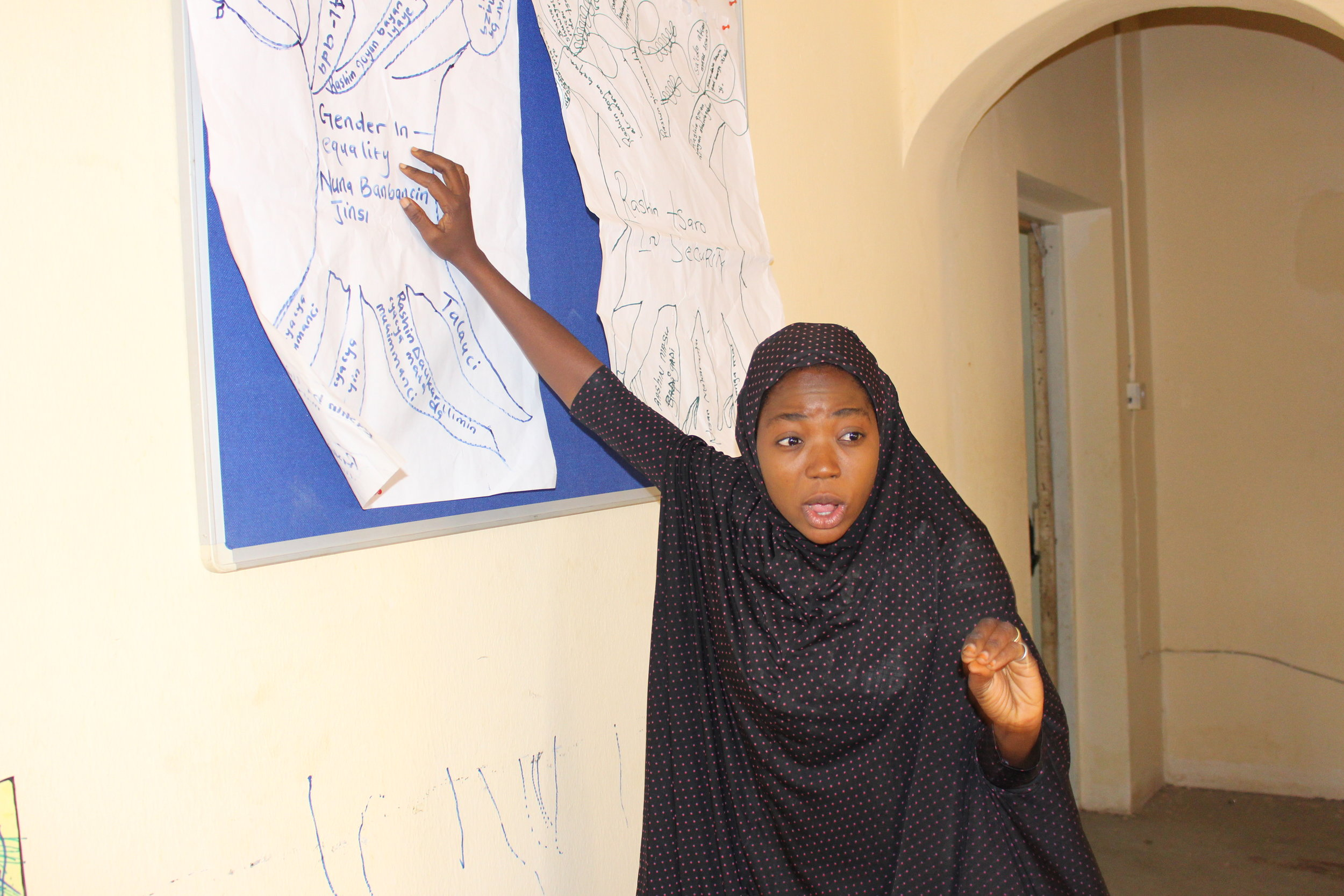 A girl presenting during advocacy training.