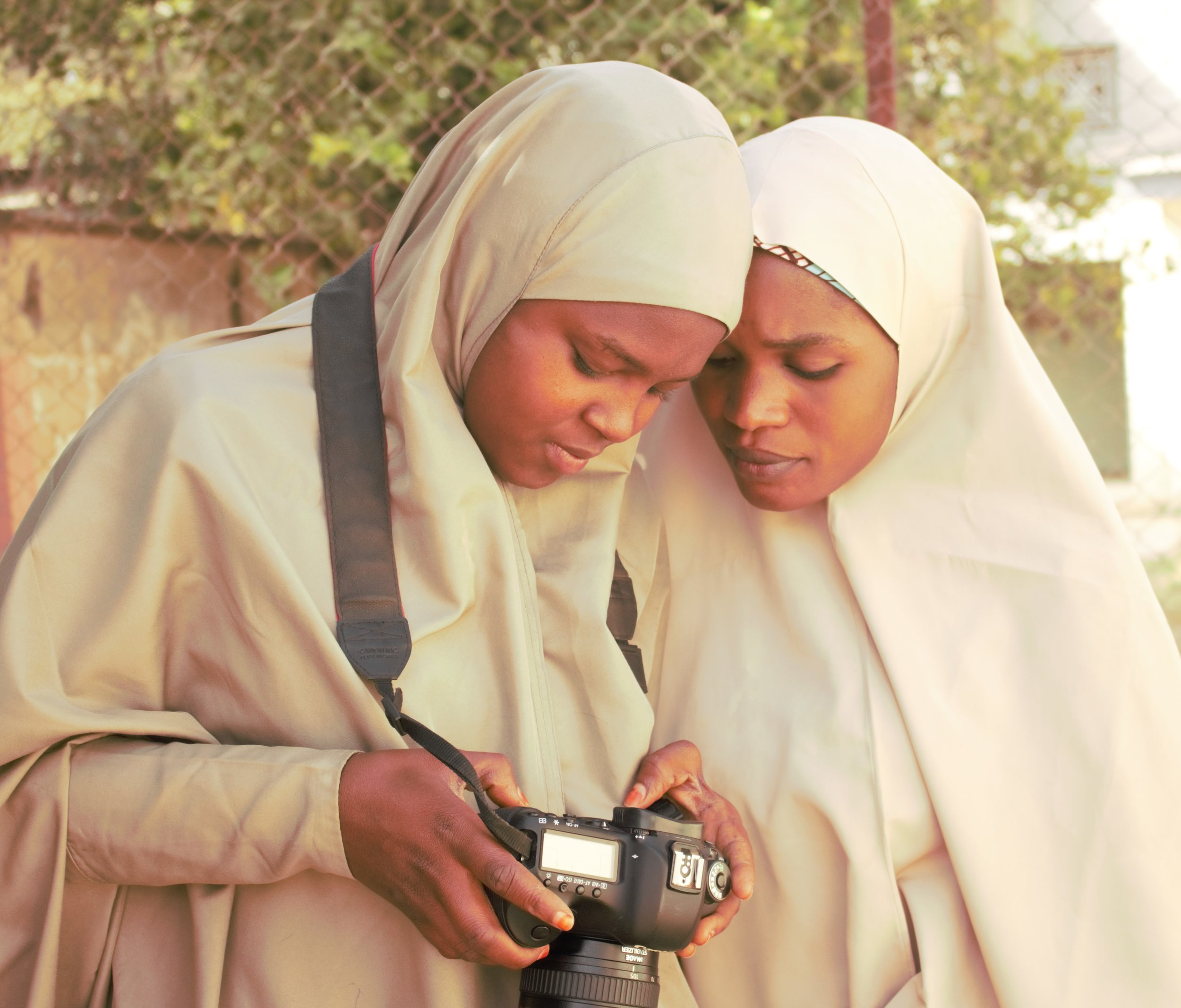 Members of the Girls Campaign for Better Education team learning during a photography training.