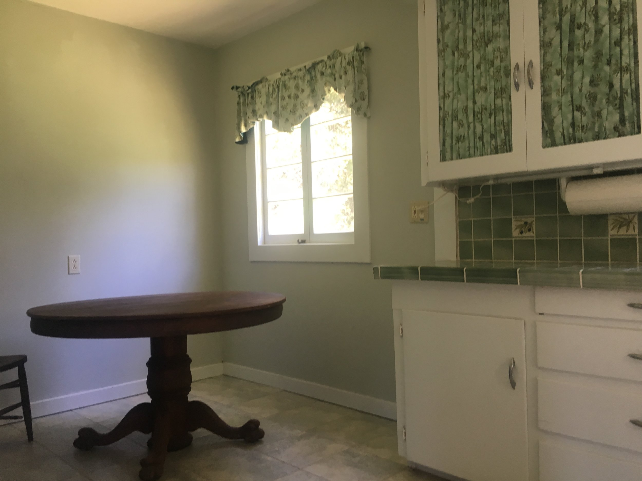 Kitchen dinning area in cabin in Yorkville for sale.