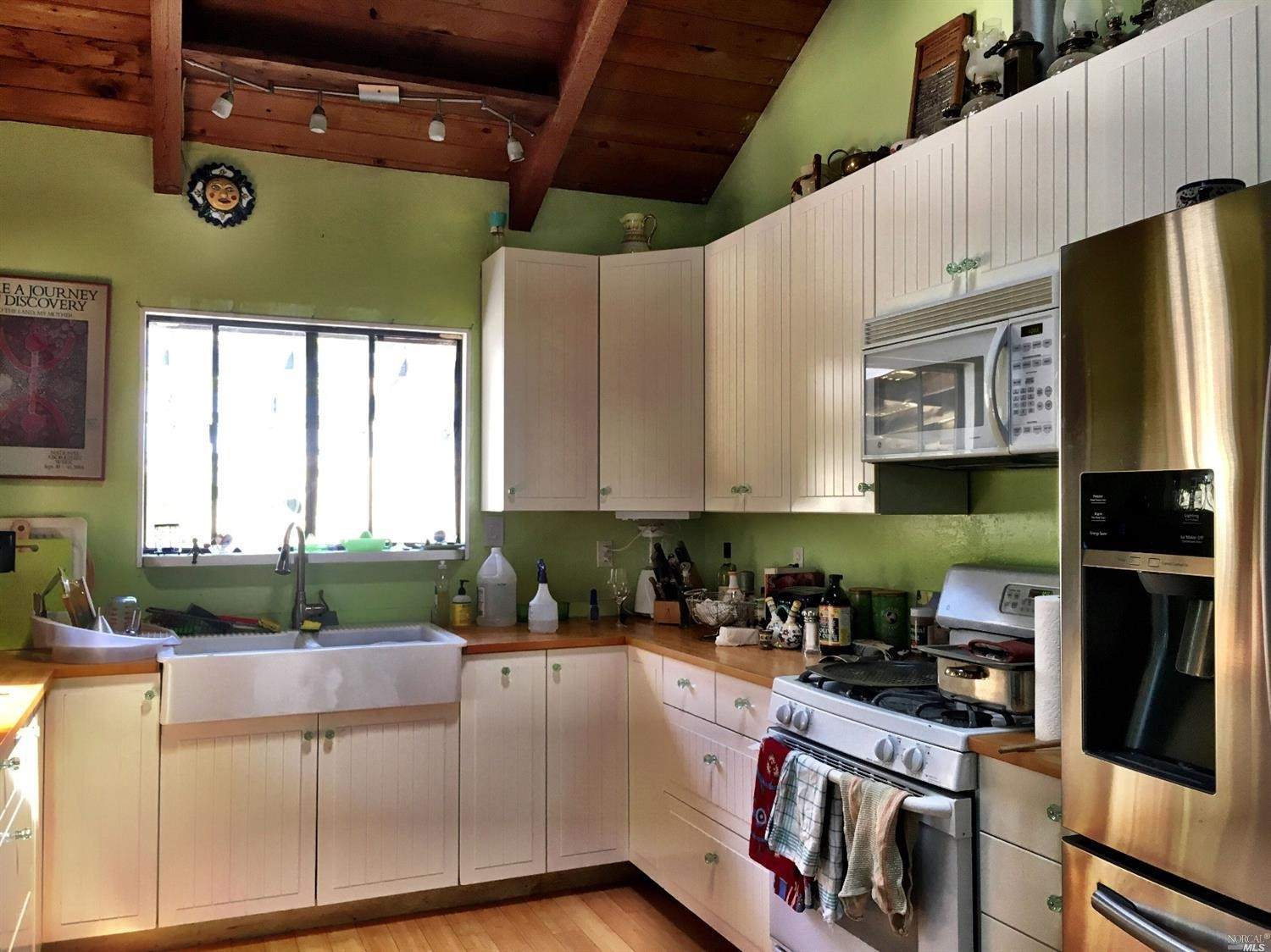 Remodeled kitchen with apron-front sink in a home for sale on Guntly Road in Philo, CA.