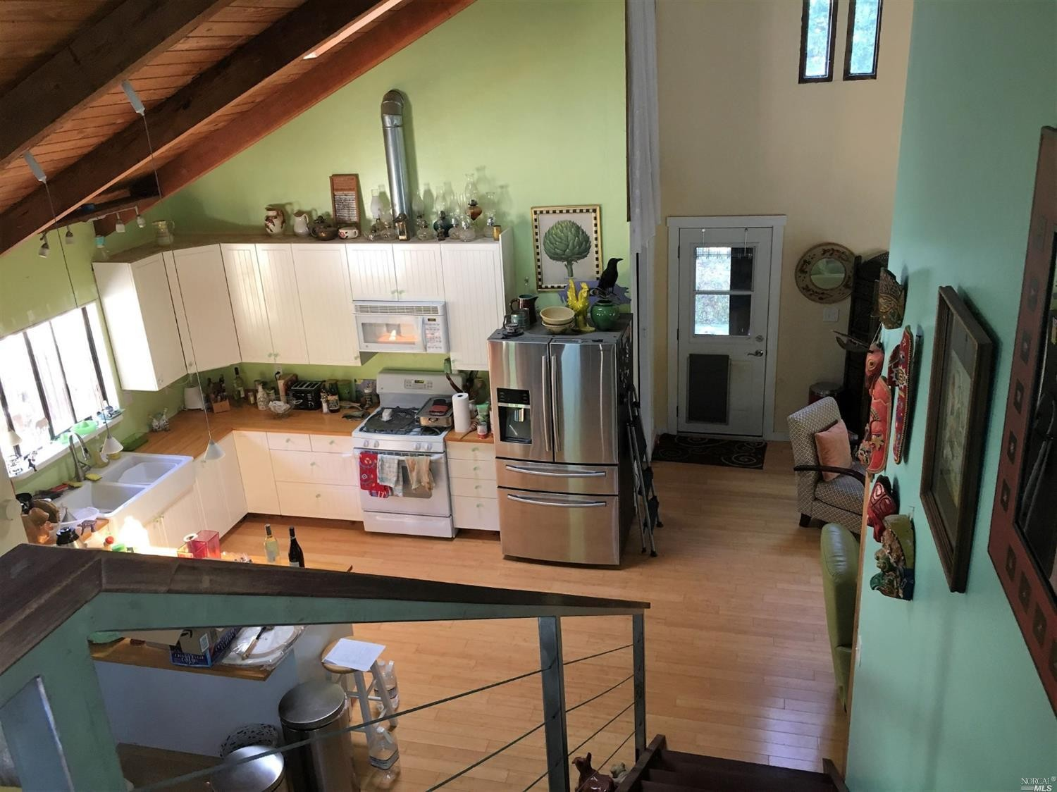Looking down at the kitchen in a home for sale on Guntly Road in Philo, CA.