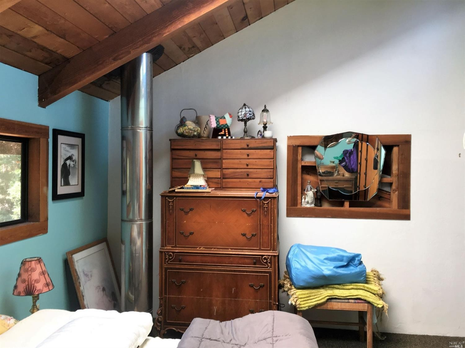 The upstairs bedroom of a home for sale on Guntly Road in Philo, CA.
