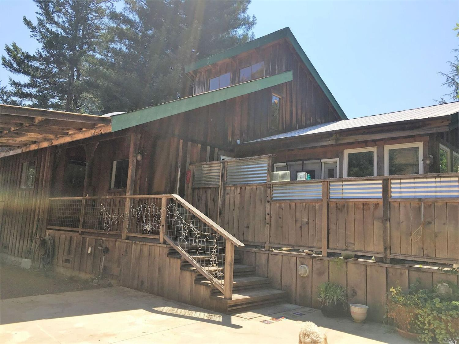 A beautiful redwood home on a property for sale on Guntly Road in Philo, CA.