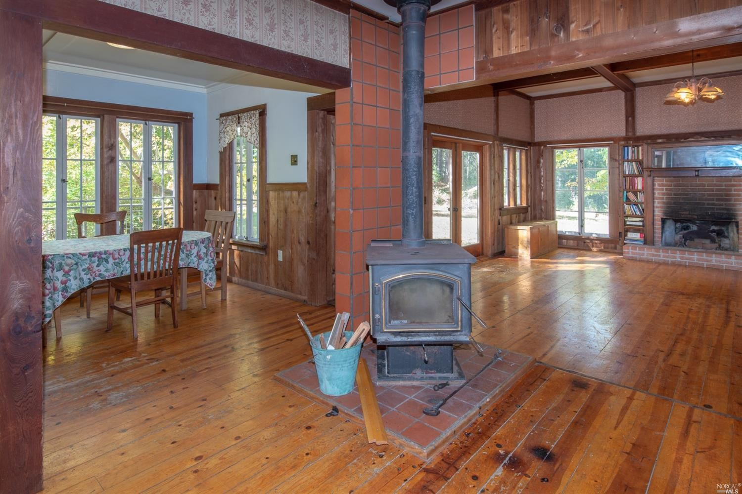 wood floors and wood burning stove in a family home for sale, Philo, CA