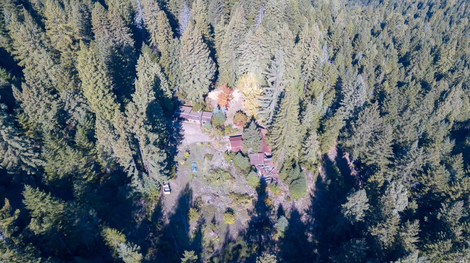 forests from above surround the family home for sale, Philo, CA