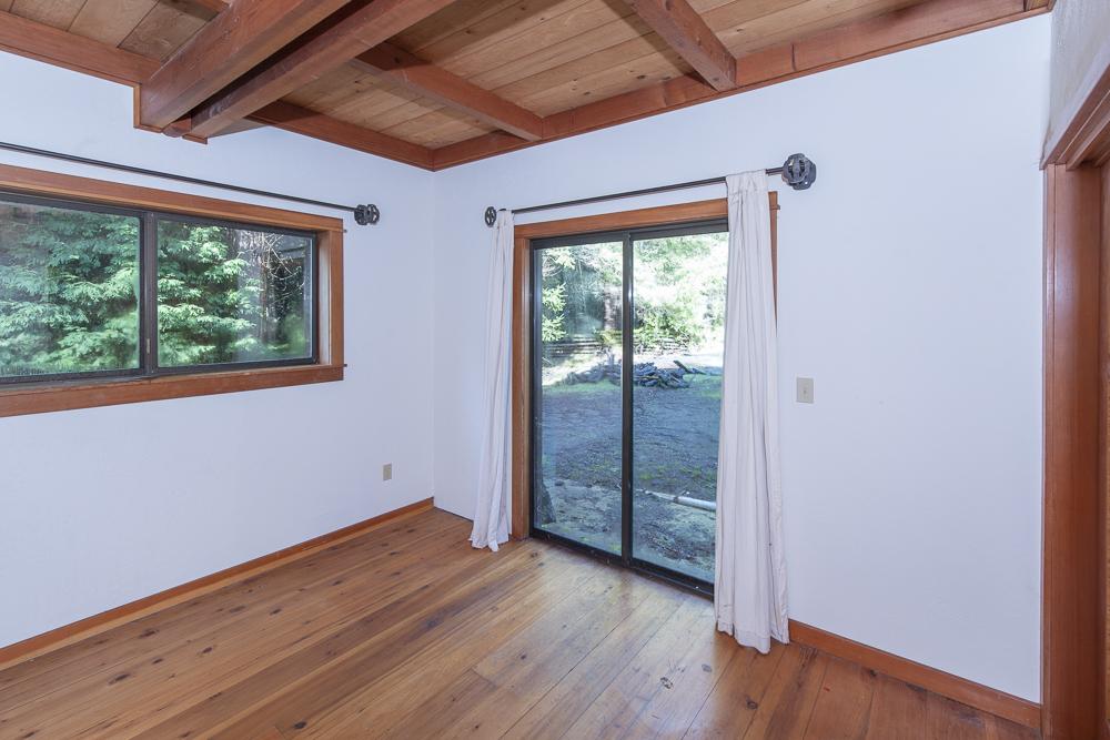 Bedroom with sliding door to deck.
