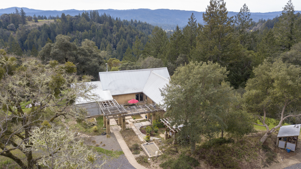 Overhead view of PISE home on 20 acres, with views over trees and valley.