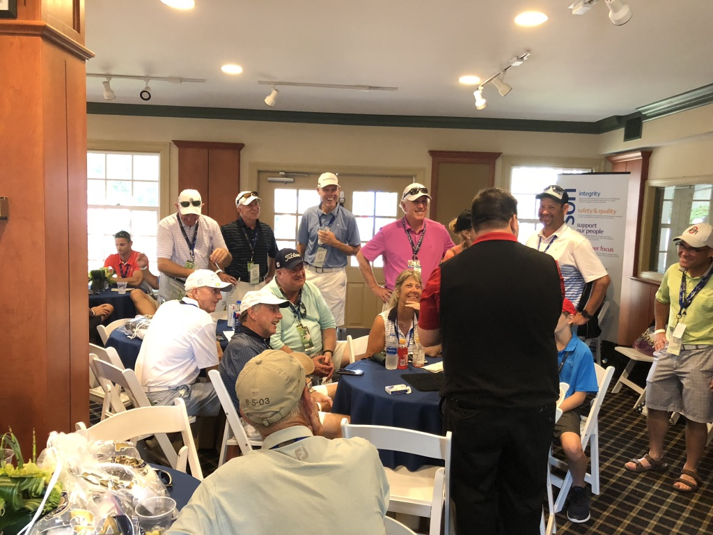 Mike entertains Emerson guests during the 20198 PGA Championship at Bellerive.
