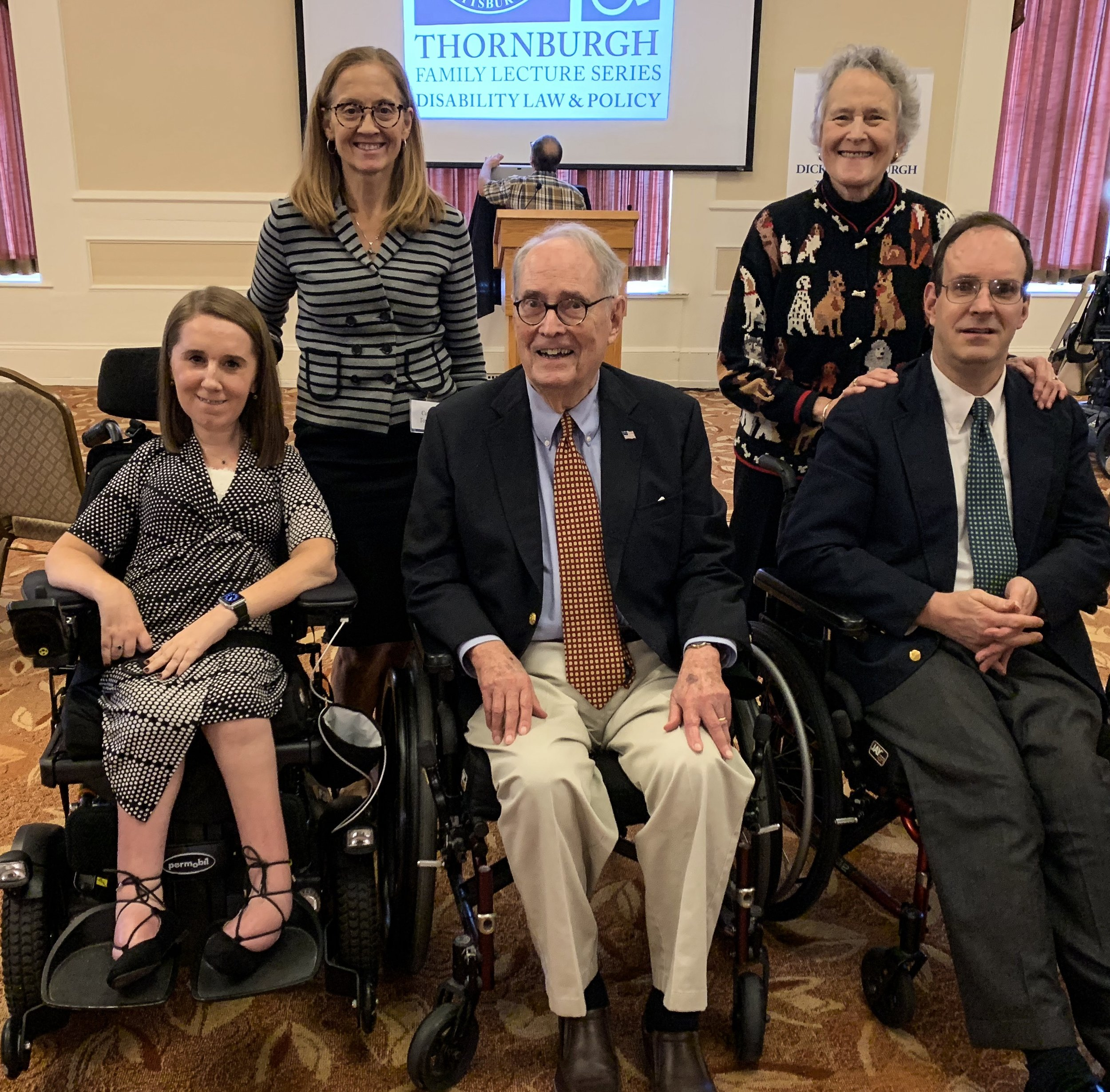 Image of Heather, former Governor of Pennsylvania Dick Thornburgh, and his son. All three people people in the photo use wheelchairs.