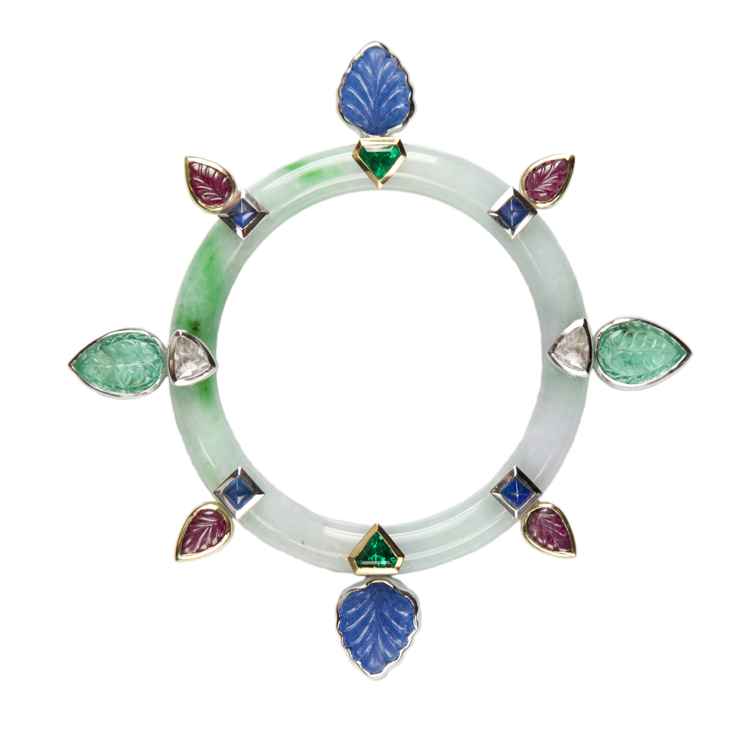 Burmese Jadeite pin with fancy carved, cabochon and faceted Emeralds (6.37 cts.), Rubies (4 cts.), Saphires (13.10 cts.) and Diamond Macles (2.05 cts.) set in 18K white and yellow Gold