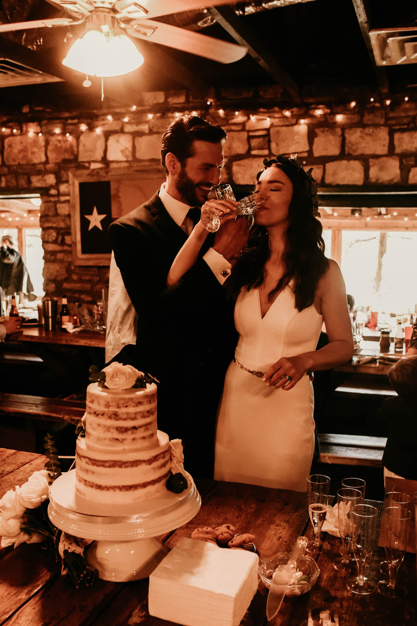 Intimate wedding toast at the salt lick in Austin, Texas