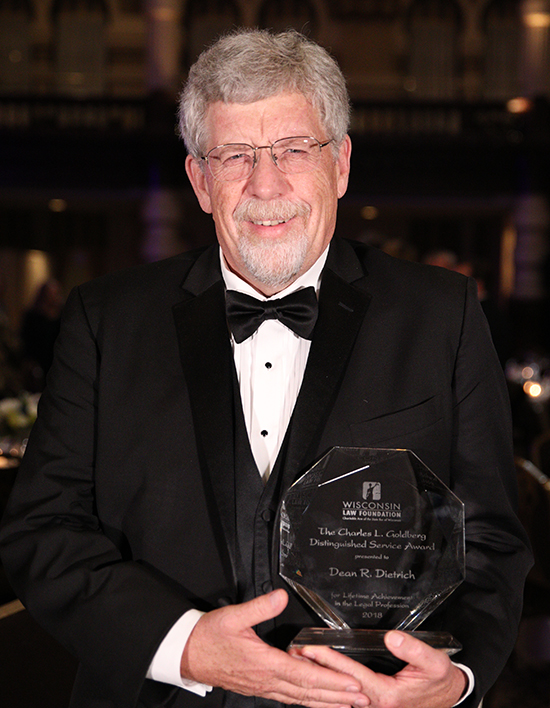 Dean Dietrich holding the 2018    Charles L. Goldberg Distinguished Service Award   .