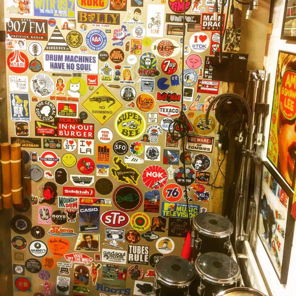 I love stickers ! I have 2 walls that are stickered up in my studio. I collect them on my travels.