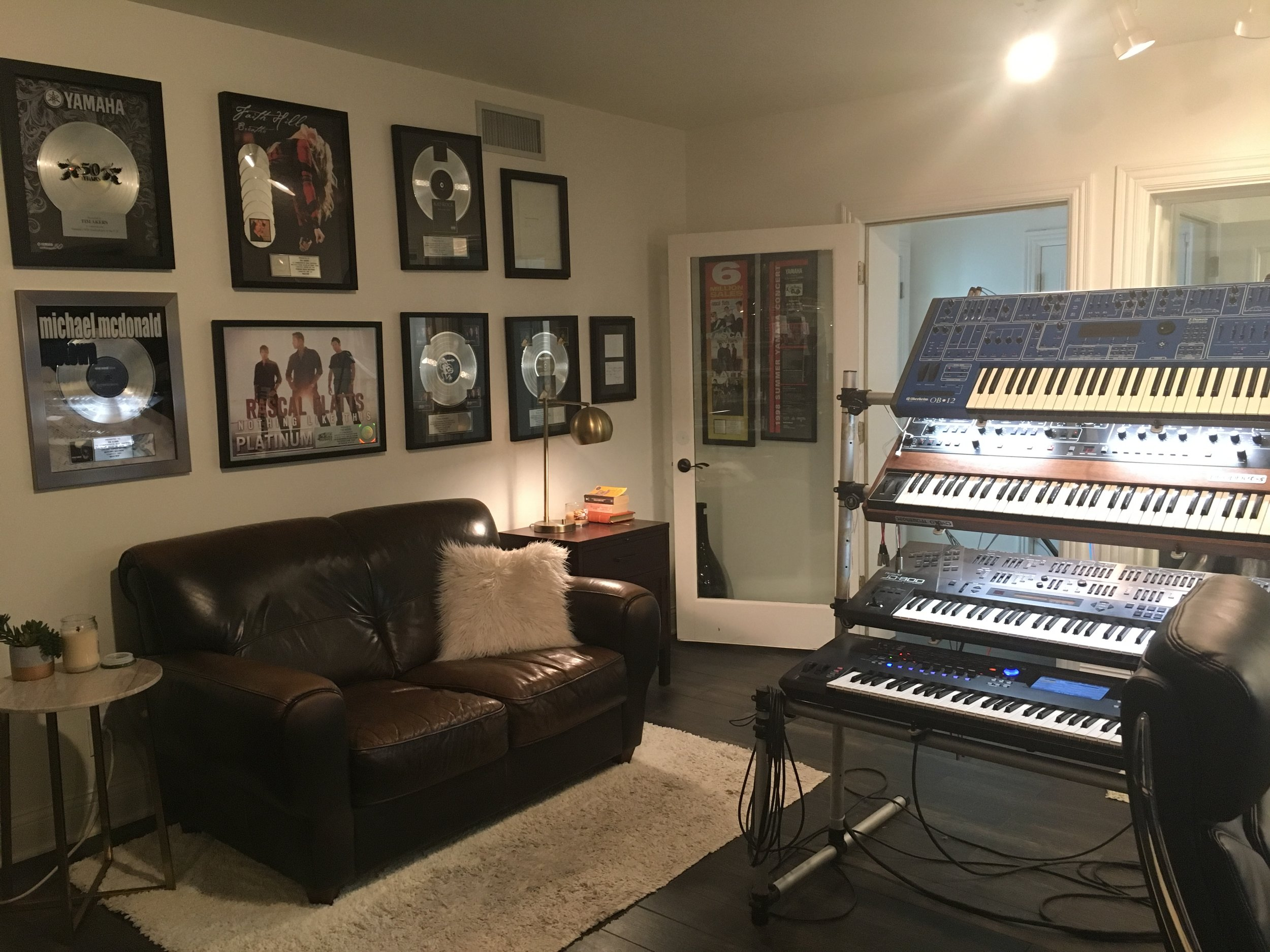 "Control room view 2 , (with patented ""Dig Me"" wall HAHA!!!) And some of my keyboard tools….Oberheim OB12, Prophet 5, Roland JD-800, and a Yamaha Montage 7.. Oh, I have more toys too."