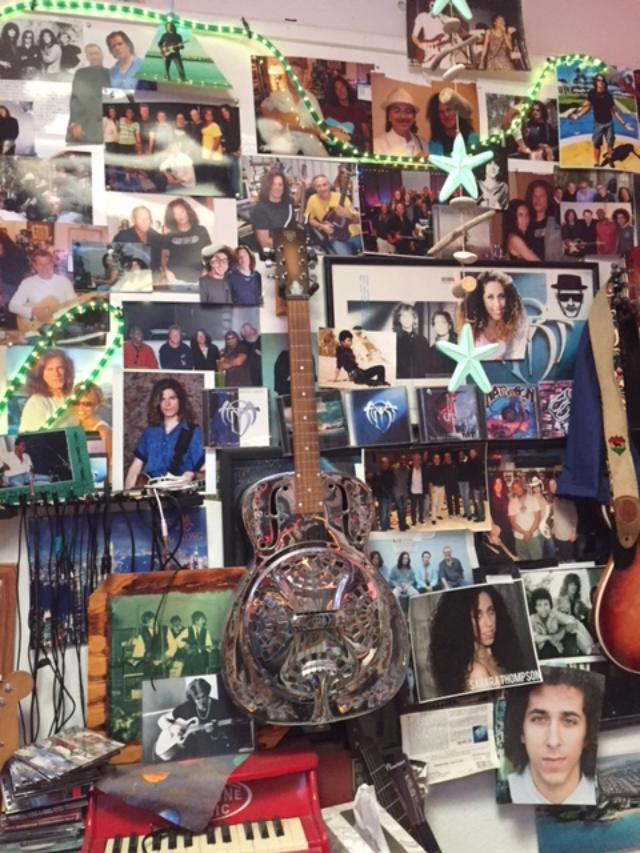 """I've added a """"wall of friends"""" in my studio and it keeps growing. Most of the images were taken after sessions. Can you find Carlos Santana and me?"""