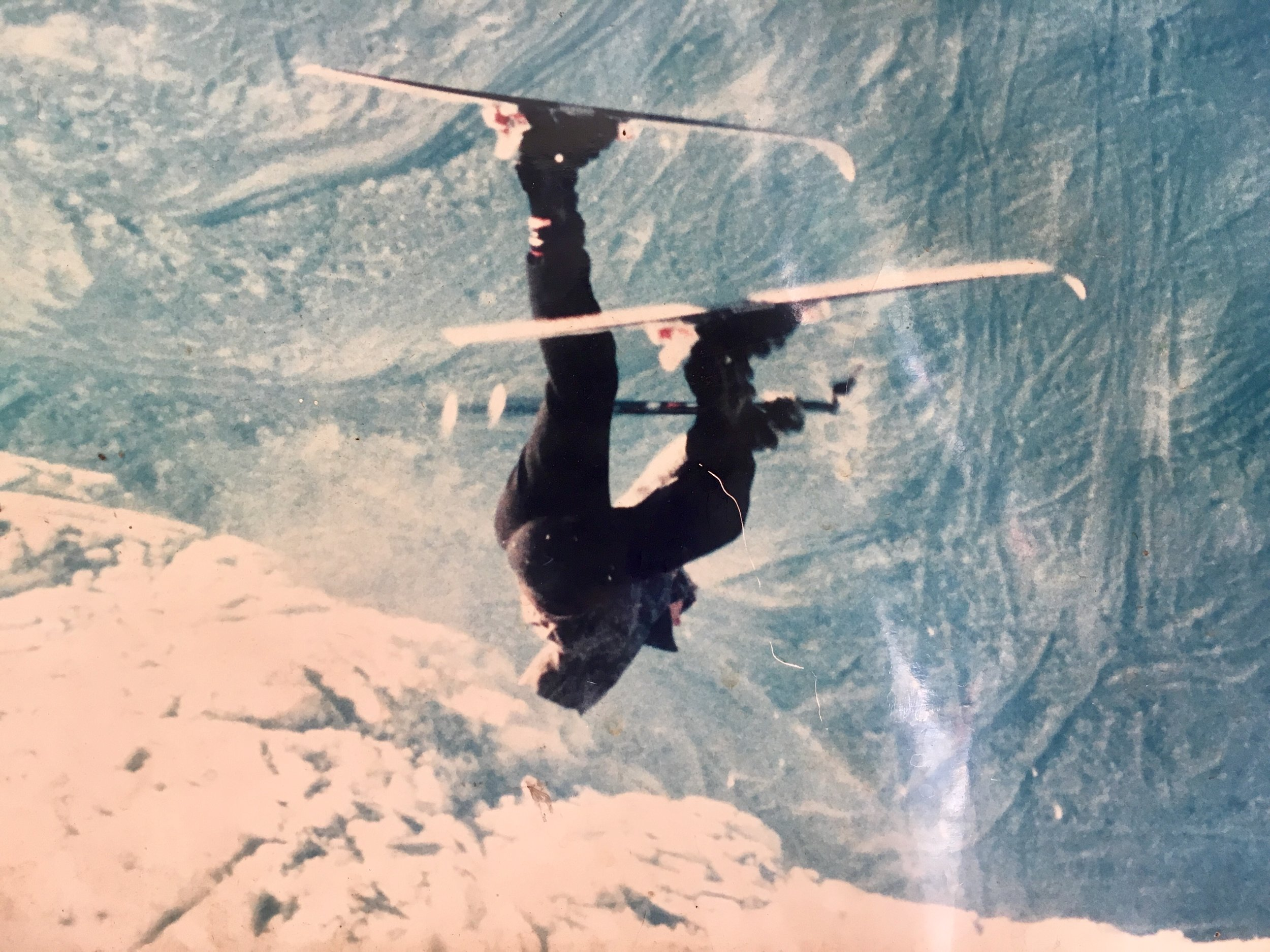 Porridge Bowl at Bear Valley - The year was 1987, hand-stand going up the cornice. While the picture looks like I'm headed downward my moving trajectory is actually going up over the cornice.