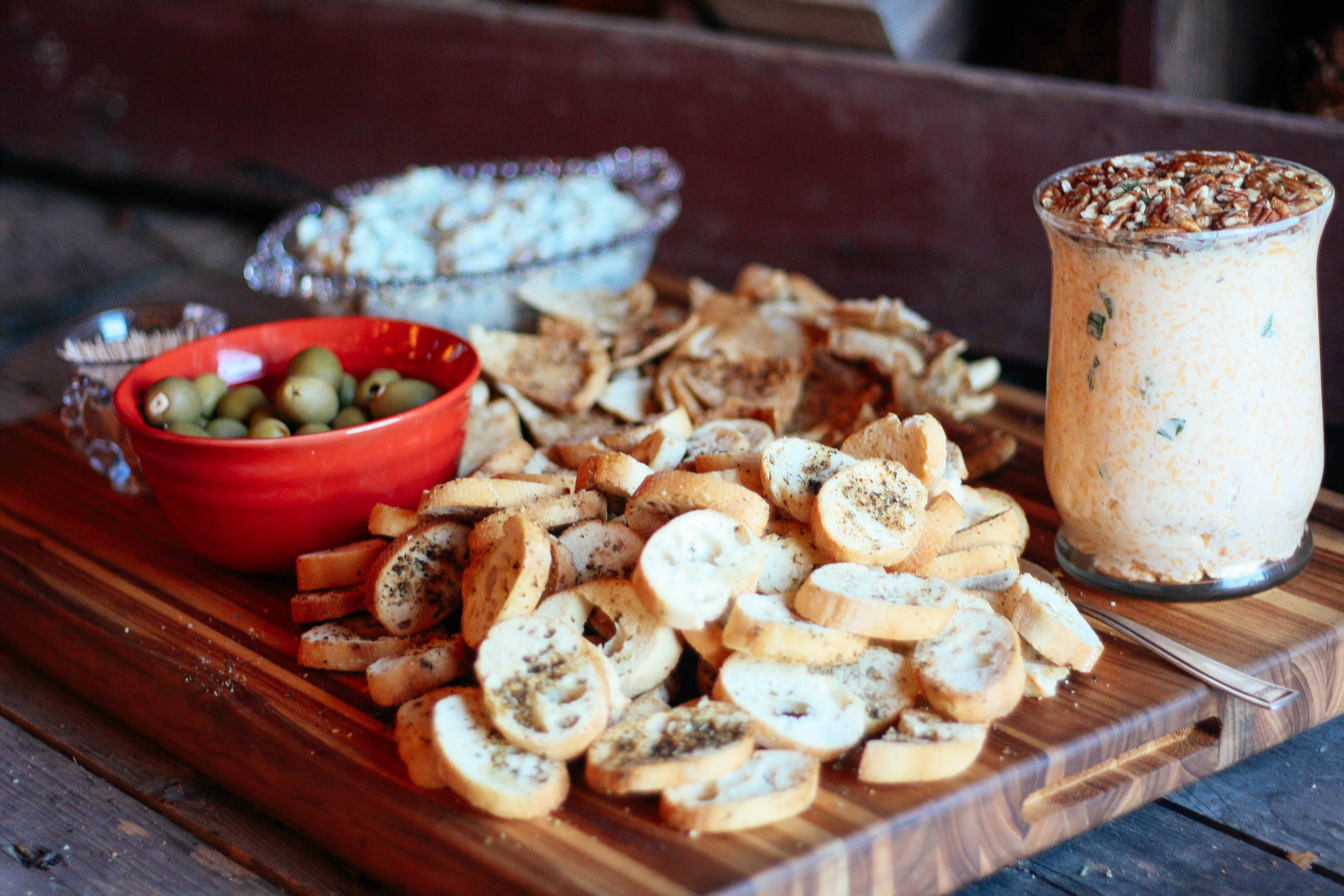 """Homemade pimento cheese dip with local pecans, specialty olives and our """"secret seasoned"""" bread bites!"""