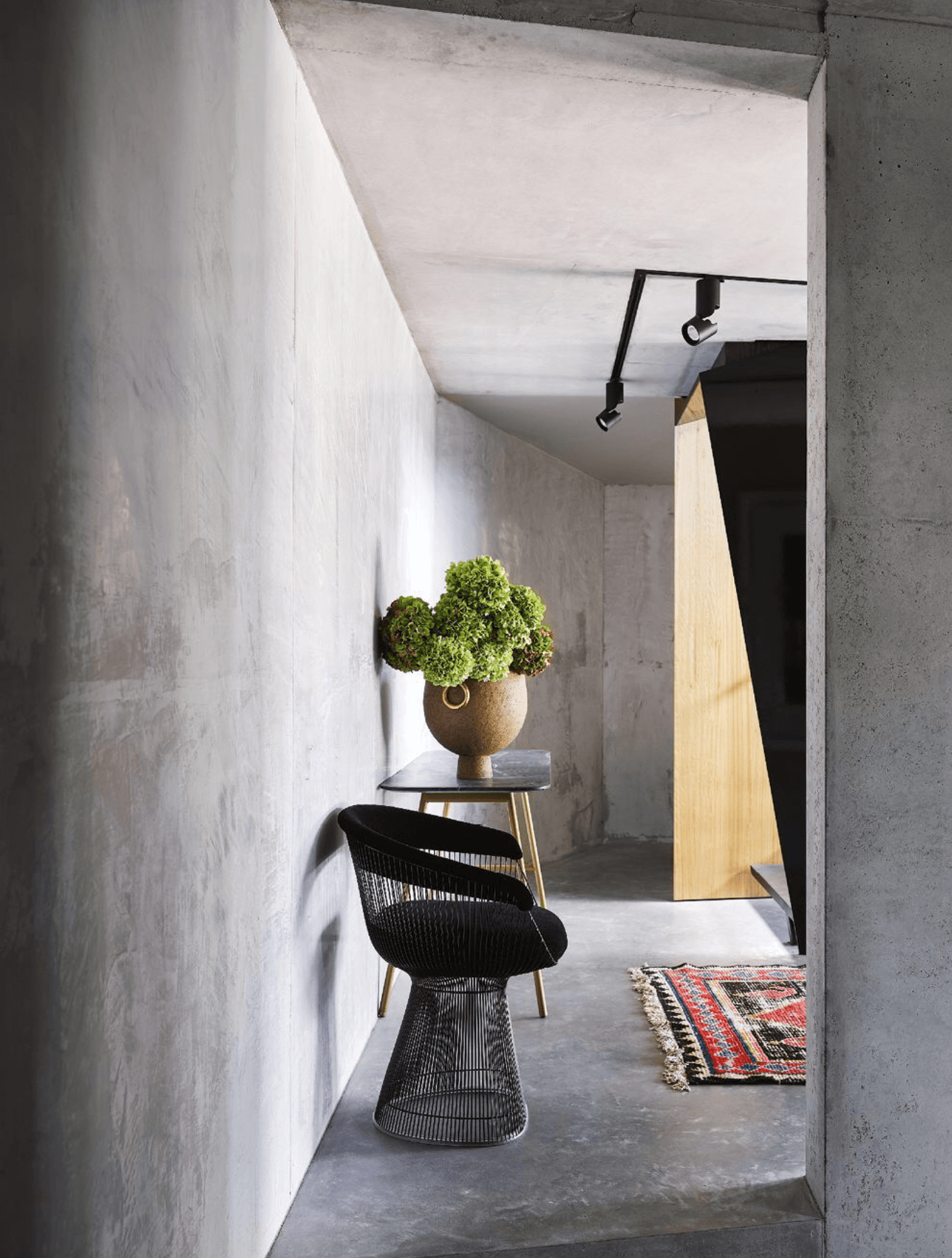 Copy of Concrete Foyer/Entryway with Platner armchair and a vintage Moroccan rug