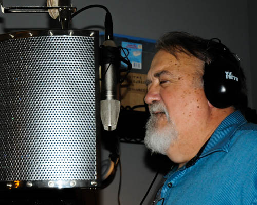 David recording a song in the studio.