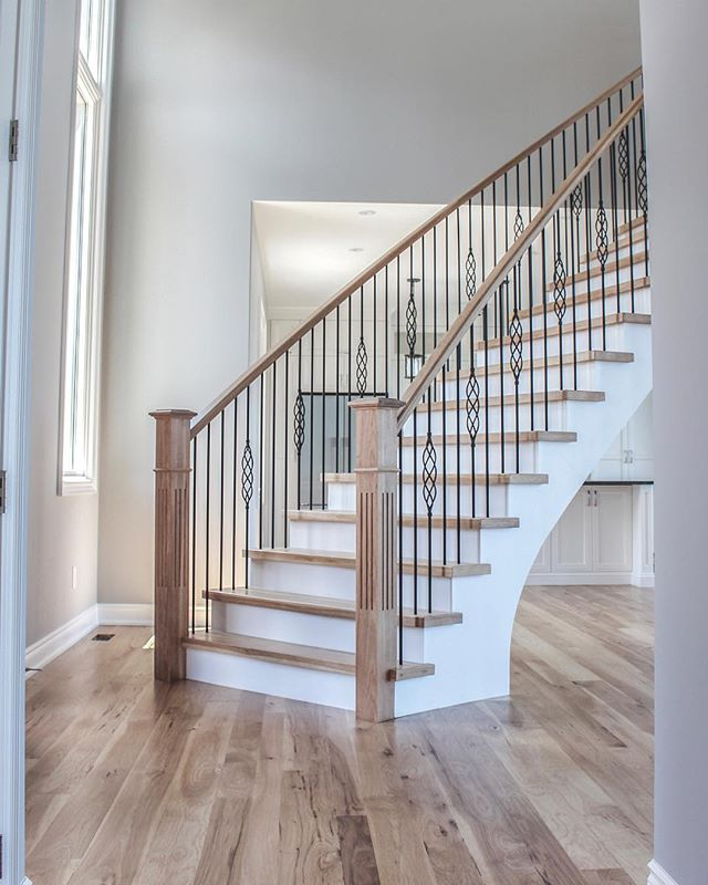 A slight curve and wider base add a strong yet elegant feel to these stairs. Completed by @stairhaus_inc 👌🏼 • • • • • •  #vandermeerhomes #customhomes #custombuild #homeinspiration #collingwood #bluemountain #homebuilders #newbuild #customhomedesign #collingwoodbusiness #homeinspiration #homedesign #staircase #homeinterior #stairinspiration #naturallight #interiordesign #stairs #curvedstaircase