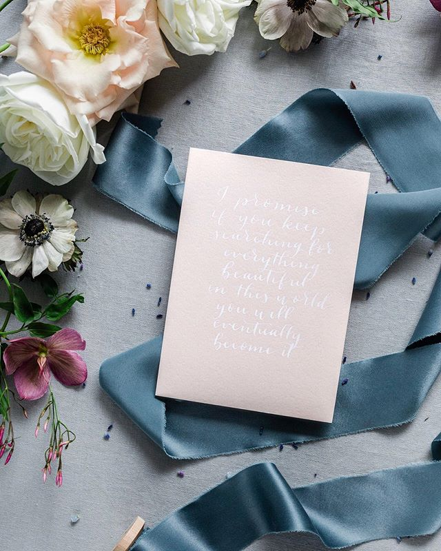 """I enjoy the subtlety of this white ink on the blush paper...until it came time to take photos 🤦🏻♀️ - """"I promise if you keep searching for everything beautiful in this world, you will eventually become it"""" - Tyler Kent White - Ribbon: Aegean Blue by @courtneyinghram -  #gatherandadorn #handlettered #handlettering #design #customdesign #moderncalligraphy #calligraphy #modernlettering #lettering #weddingstationeryboss #virginiacalligrapher #hamptonroadscalligrapher #quotes #floral #flowers #wordsofwisdom #styledflatlay #ribbon #silkribbon #handdyedsilkribbon #courtneyinghram"""
