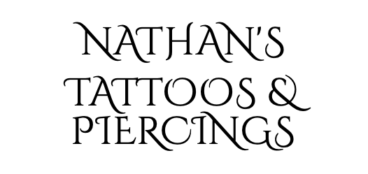 """Body Art - Nathan's Tattoos & Piercings was founded in Canoga Park in 2000 by Norwegian-American Nathan Peterson. Nathan operates the store with the help of his wife Crystal and a string of professional tattoo and piercing artists. Nathan's philosophy on piercing is that everybody deserves to be pierced in a safe environment using aseptic technique with a piercer that cares about the client; whether it's the client's first or 20th piercing. He believes in """"loving his neighbor as himself"""" no matter one's culture, race, background, orientation, etc. Ultimately it's his goal to provide the safest, cleanest, most knowledgeable and friendly experience when it comes to piercing.In 2000, after seven years in the professional industry, he had the opportunity to open his own shop. He felt led to open his own shop because he had a vision of how shops should be run that was rarely happening, and to a degree, still isn't currently that common.Nathan wanted to incorporate tattoos in the shop because he finds that both tattoos and piercings are beautiful forms of artistic expression on the human body. He loves when he's given the opportunity to intermix the two by being able to incorporate dermal anchors, surface barbells, scarification or branding with a tattoo. He also finds the rich history of tattooing and piercing in America, as well as internationally, fascinating. Nathan enjoys studying and collecting antiquities pertaining to both tattoos and piercings. One can find his collections intermixed in the jewelry display cases in the lobby of the shop!"""