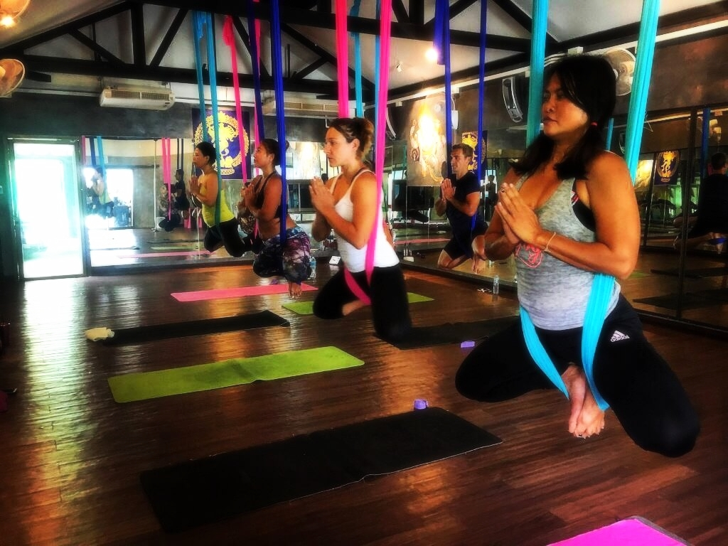 Aerial yoga classes at 5 Elements Hot Yoga Resort in Phuket, Thailand.