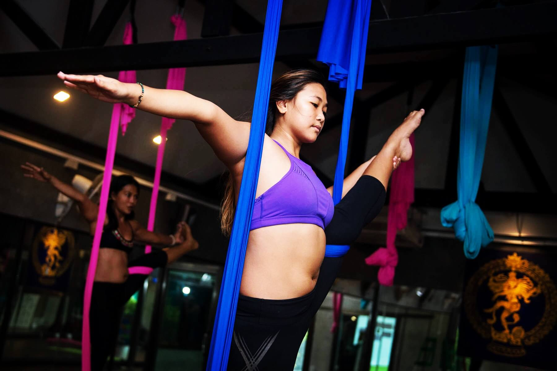 Kru Instructor Yuyi teaches all classes with an Emphasis on Aerial Yoga at 5 Elements Hot Yoga Resort in Phuket, Thailand.