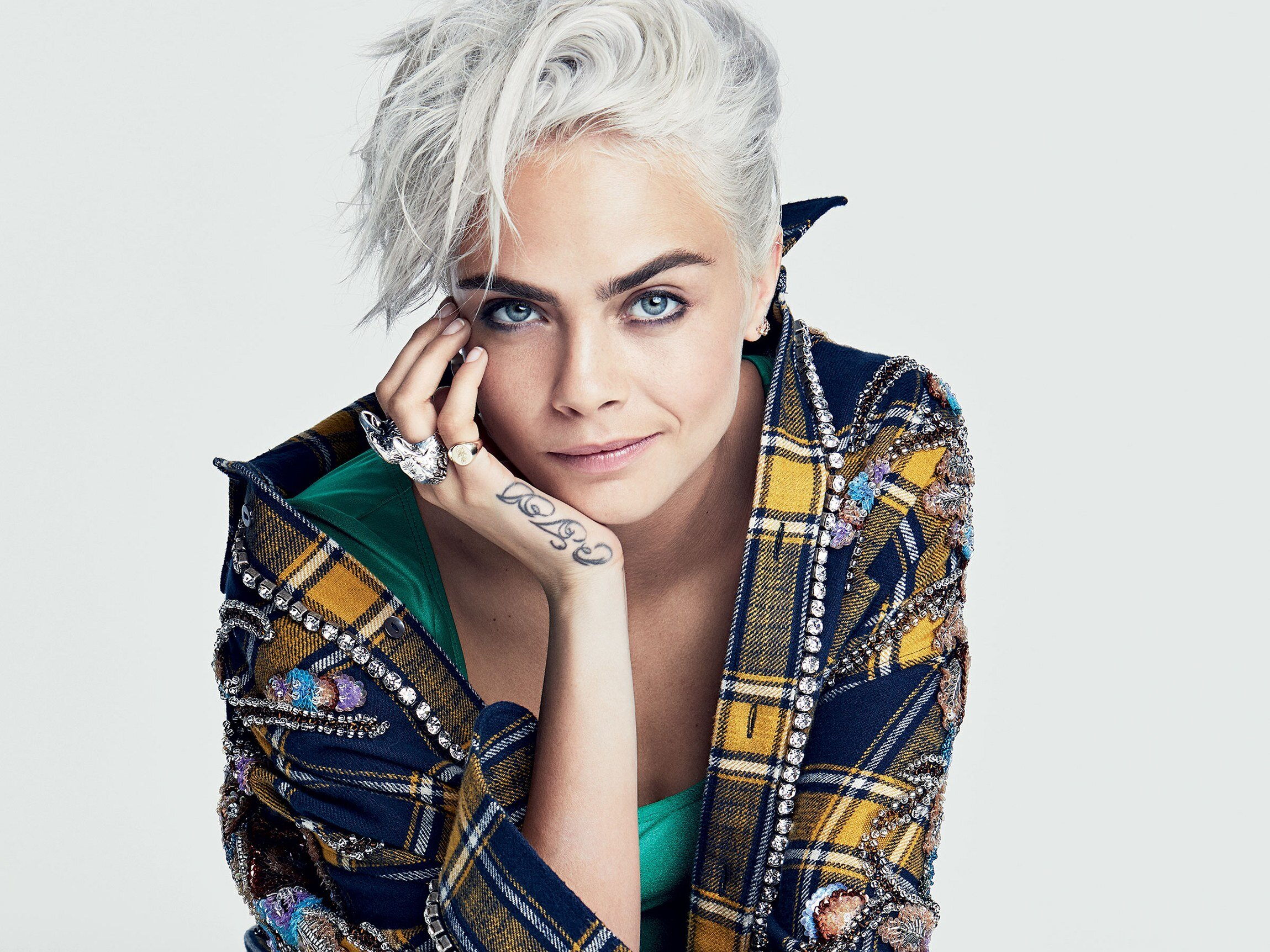 """At 22 she talked about her attraction to both men and women. She dated musician Annie Clark (stage name St. Vincent) for a year and a half, a relationship that taught her """"what love was—real love."""" In a rap battle with James Corden and Dave Franco, she joked, """"I've hooked up with hotter girls than both of you combined."""" And many women identify: """"I love Cara Delevingne,"""" one fan wrote on Twitter. """"Her openness about her sexuality…helped me accept myself."""" Last year she took on another stigmatized issue, depression, talking about her own diagnosis in a series of interviews. """"Mental illness goes unseen,"""" she said, """"but I don't want it to be unheard."""""""