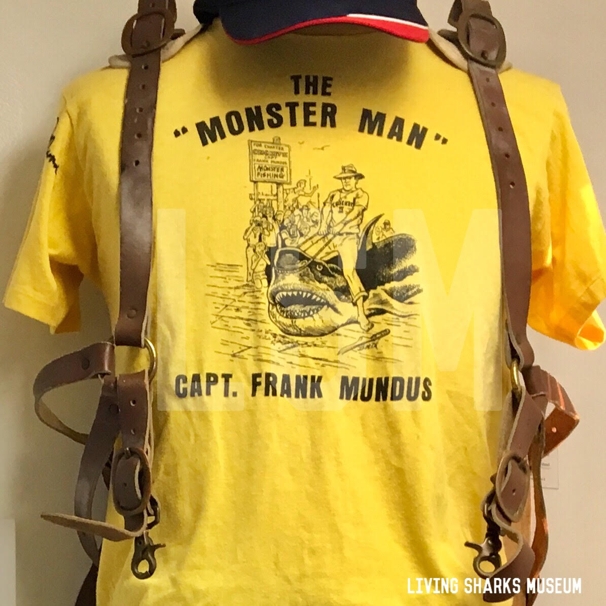 MONSTER SHIRT - Originally worn by Captain Frank Mundus himself, this actual shirt was his personal attire for photos and publicity events. When he retired from his vessel Cricket II, he autographed the shirt as a gift to his first mate and pro collector Chris Kiszka. The illustration on the shirt was designed by famed Montauk comic artist Frank Borth III, who also had whimsically illustrated books by Frank Mundus._______________________SIGNED T-SHIRT WORN BY FRANK MUNDUSFROM THE VESSEL CRICKET IIAcquired by Chris Kiszka, First Mate aboard Cricket IIPrivate Collection - Keith M. Cowley