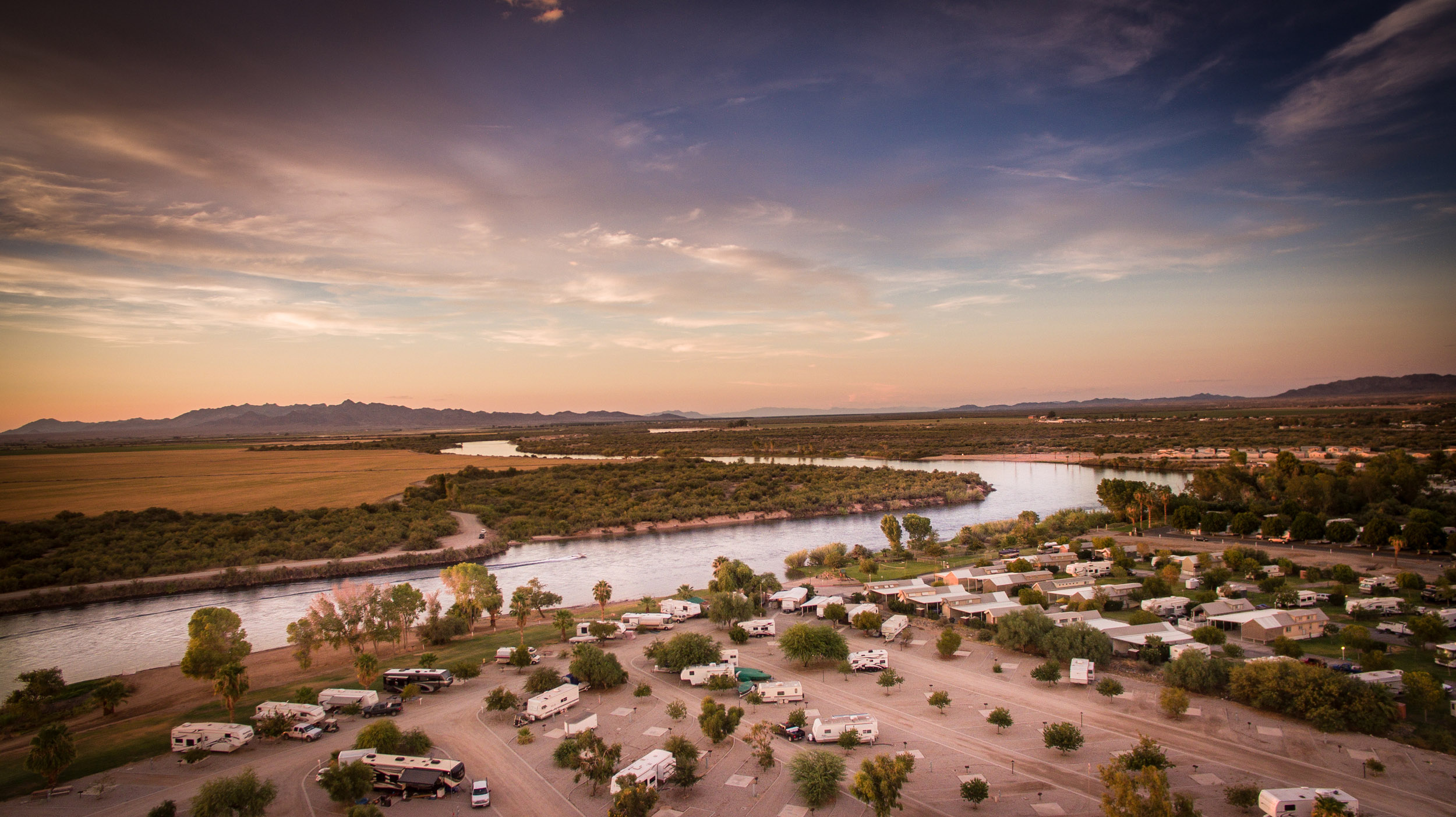 Resort Amenities - 20 minutes from Quartzsite1,000 ft. River beachFree WiFiBig rig friendlyHeated pools & spaGated communityHiking and ATV trails easily accessiblePet-friendlyBoat launchClubhouse, kitchen & meeting room