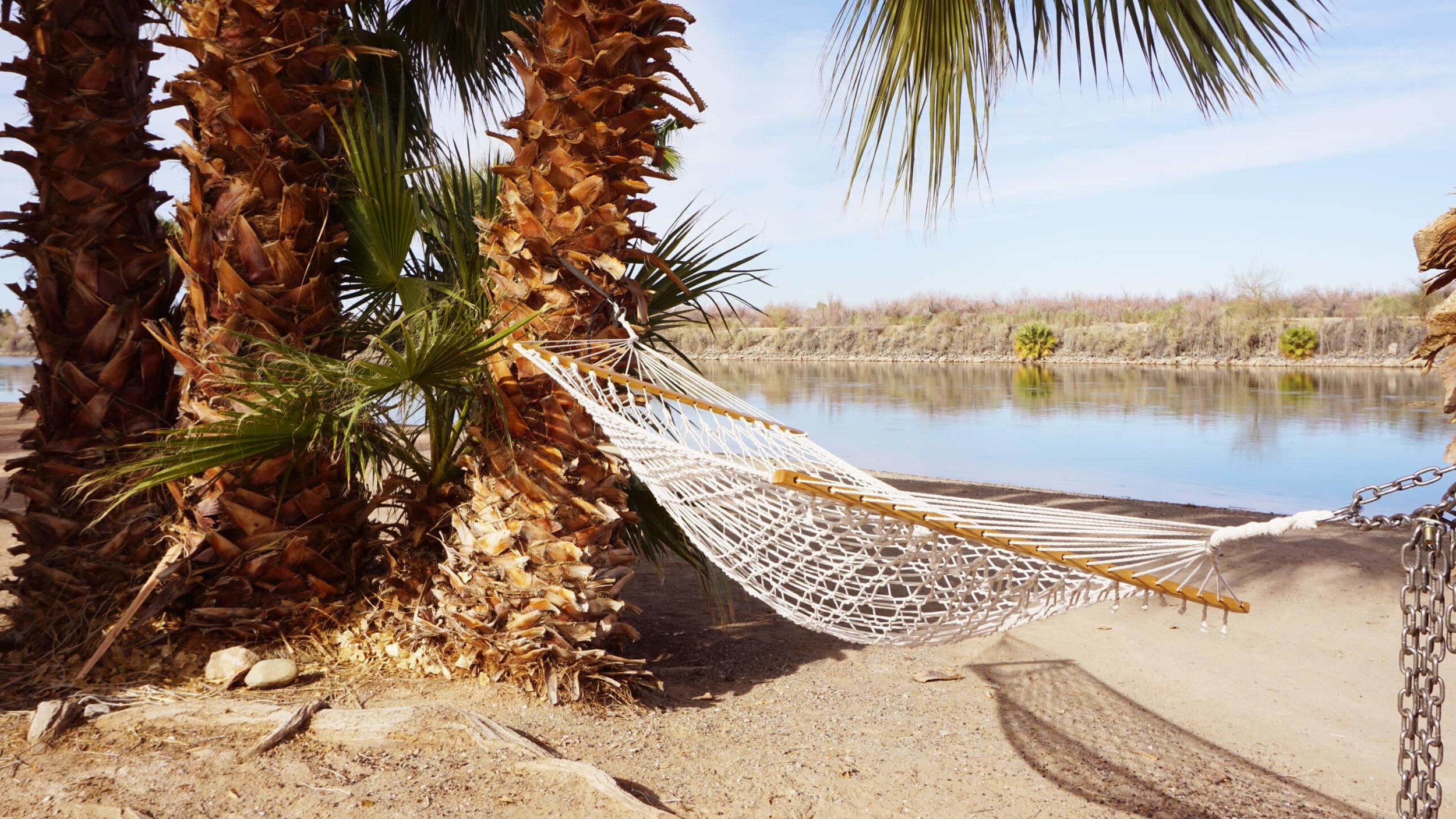 Lay in the hammock on the beach