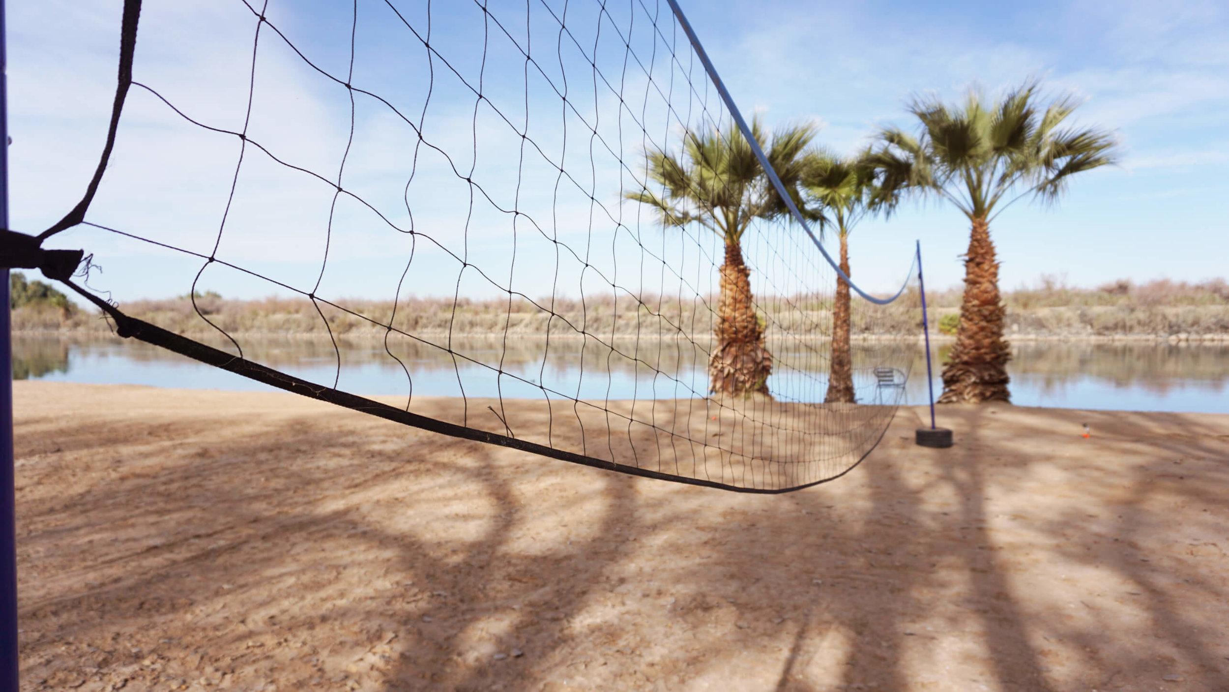 Play beach volley ball
