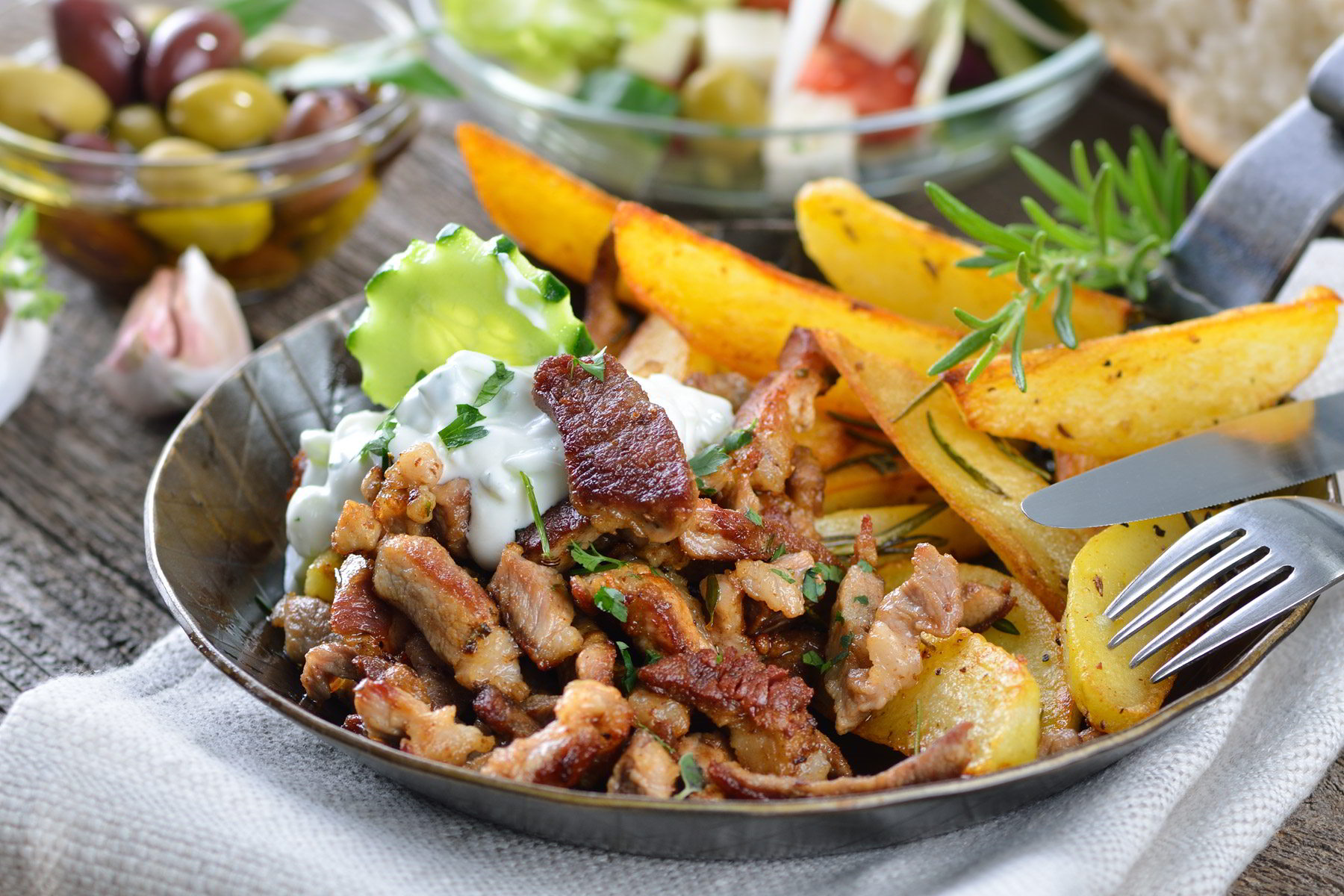 greek-pork-gyros-with-fried-potatoes-and-sauce.jpg