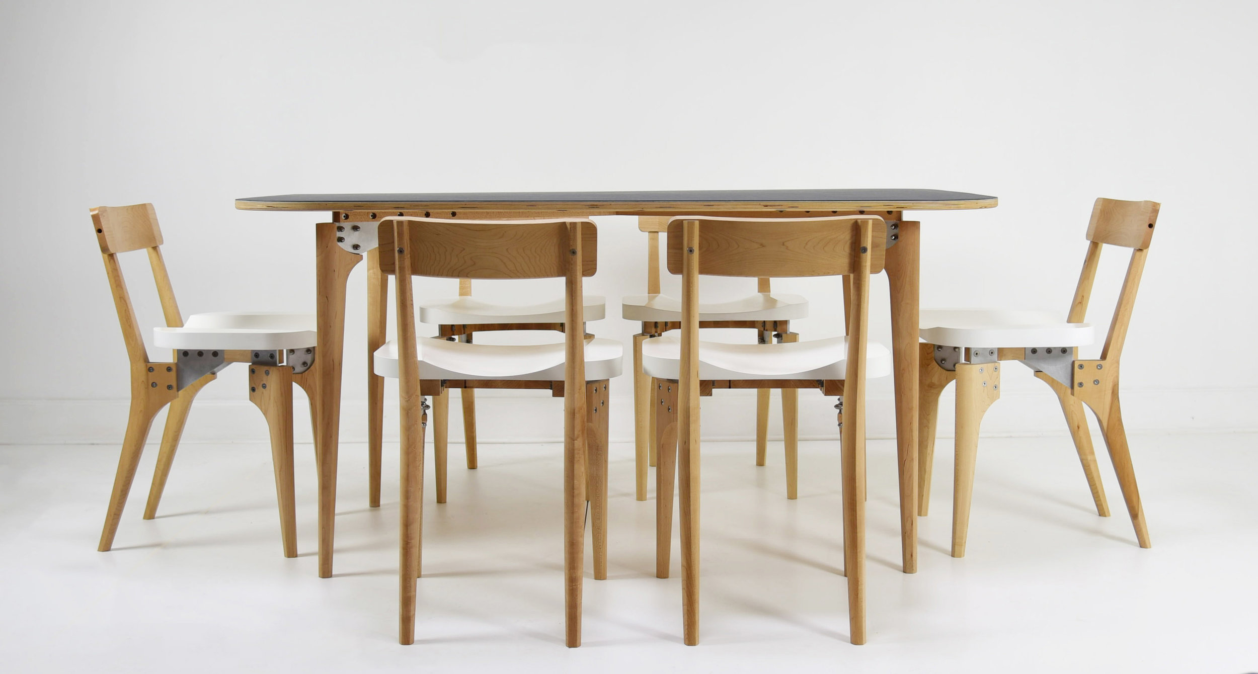 The Lofted Dining Table with Butcher Block Chairs from KHEM Studios