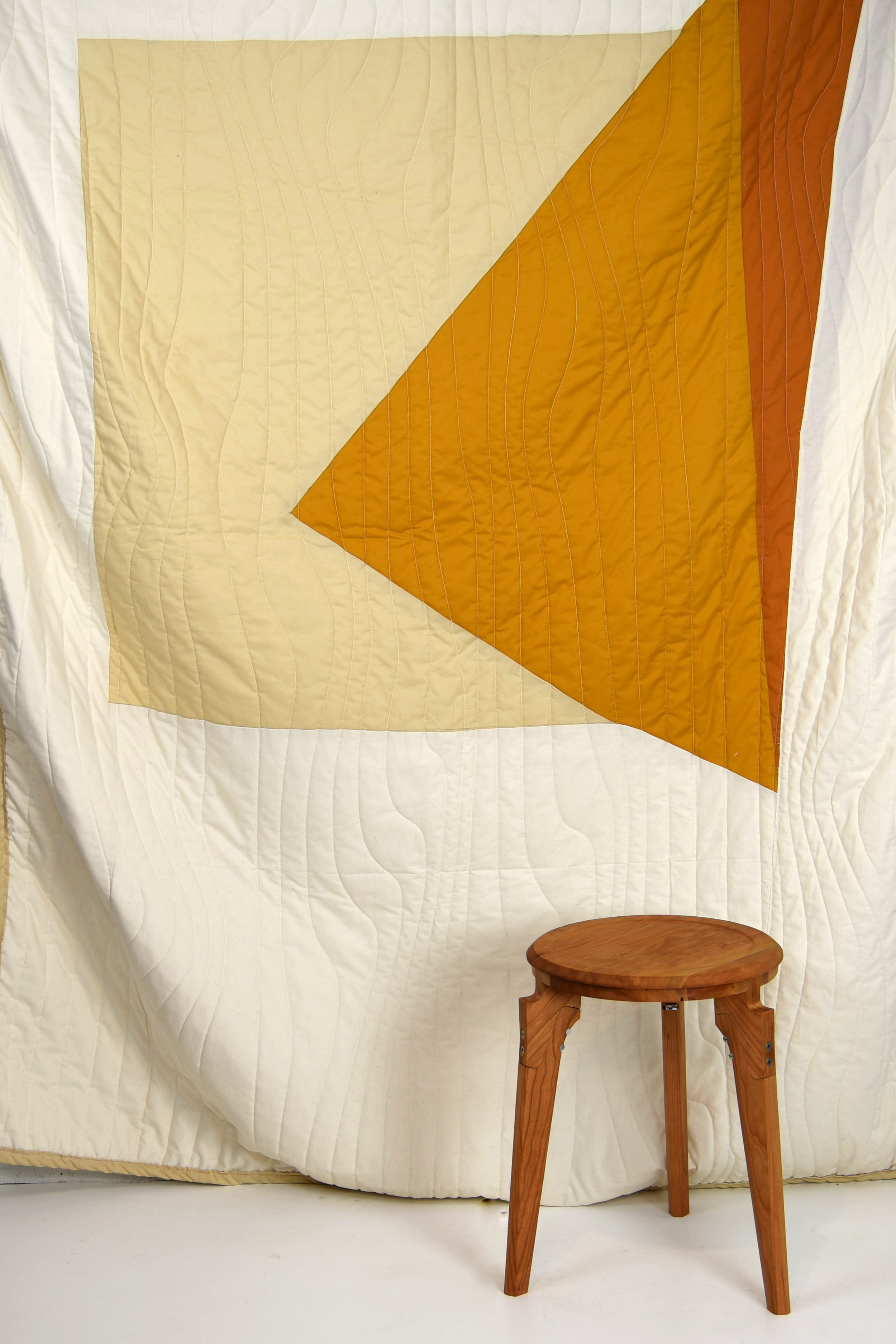 Stool and Sunset Wedge Quilt by KHEM Studios