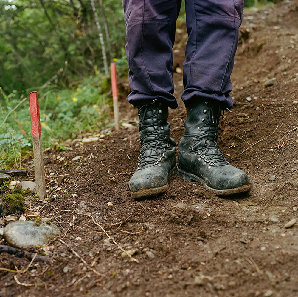 The boots of a HALO de-miner in the village of Dvani, Georgia. The team clear a hillside reported to have some grenade booby traps leftover from a former military position during the 2008 Russo-Georgian war.