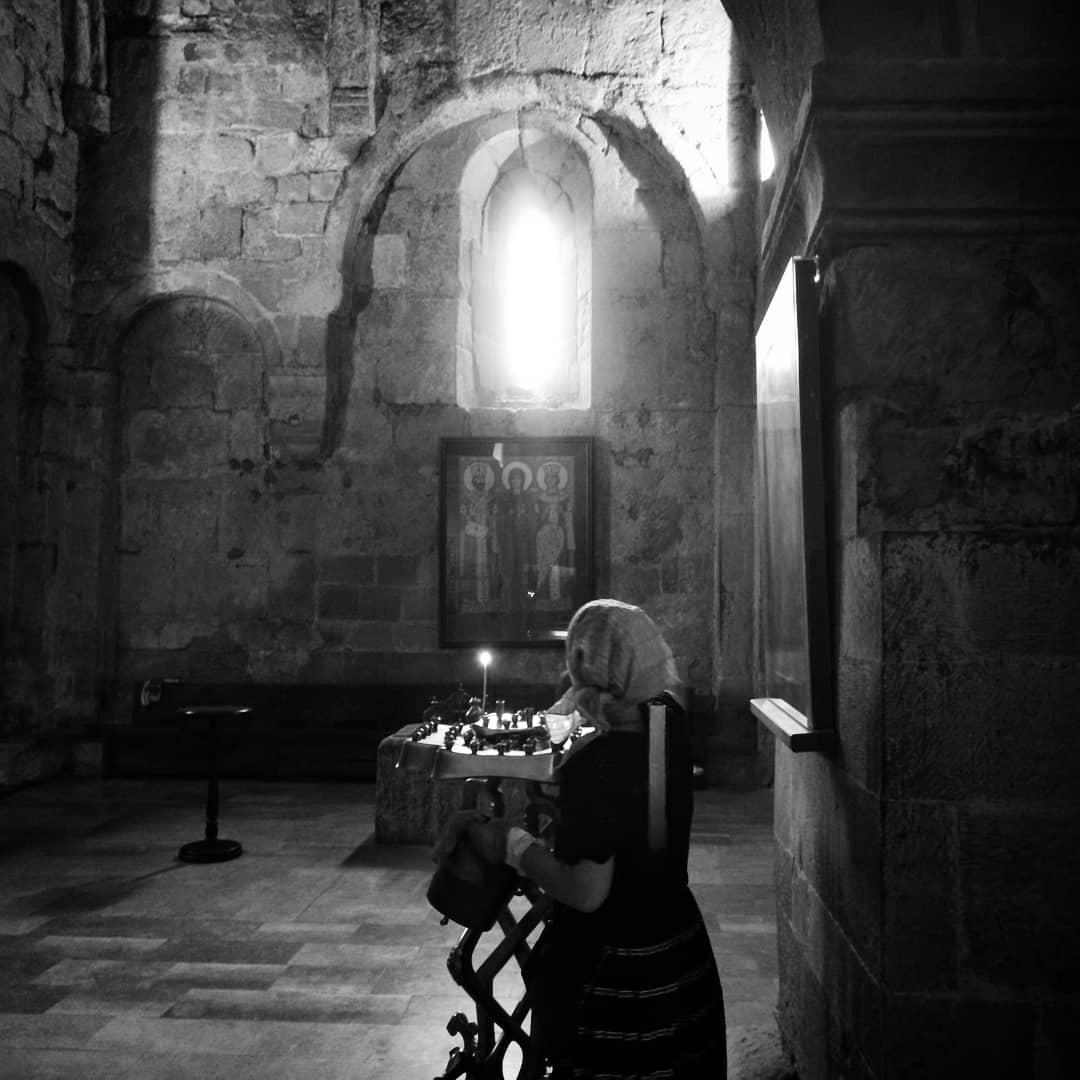 Lighting candles in Svetitskhoveli Cathedral, Mtskheta, Georgia.