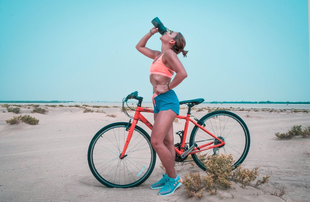woman-drinking-on-black-tumbler-while-looking-up-and-placing-1302928.jpg