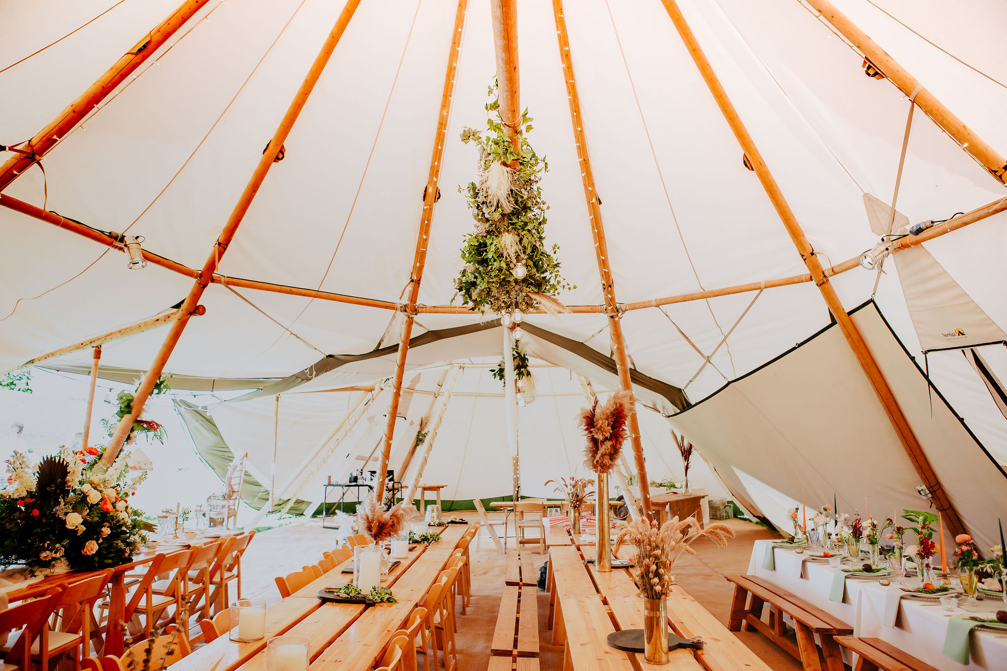 canvas-and-light-white-tipi-hire-banquet-style.jpg