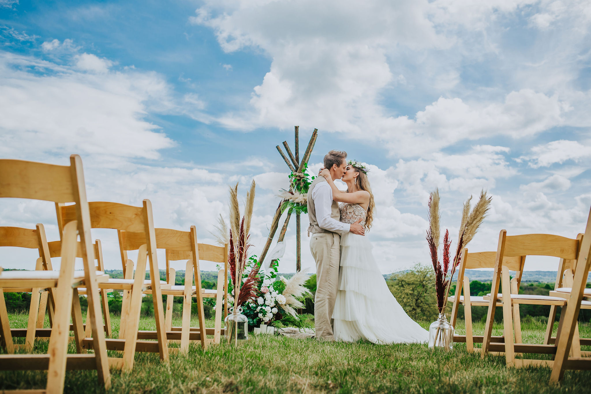 canvas-and-light-white-tipis-outdoor-ceremony.jpg