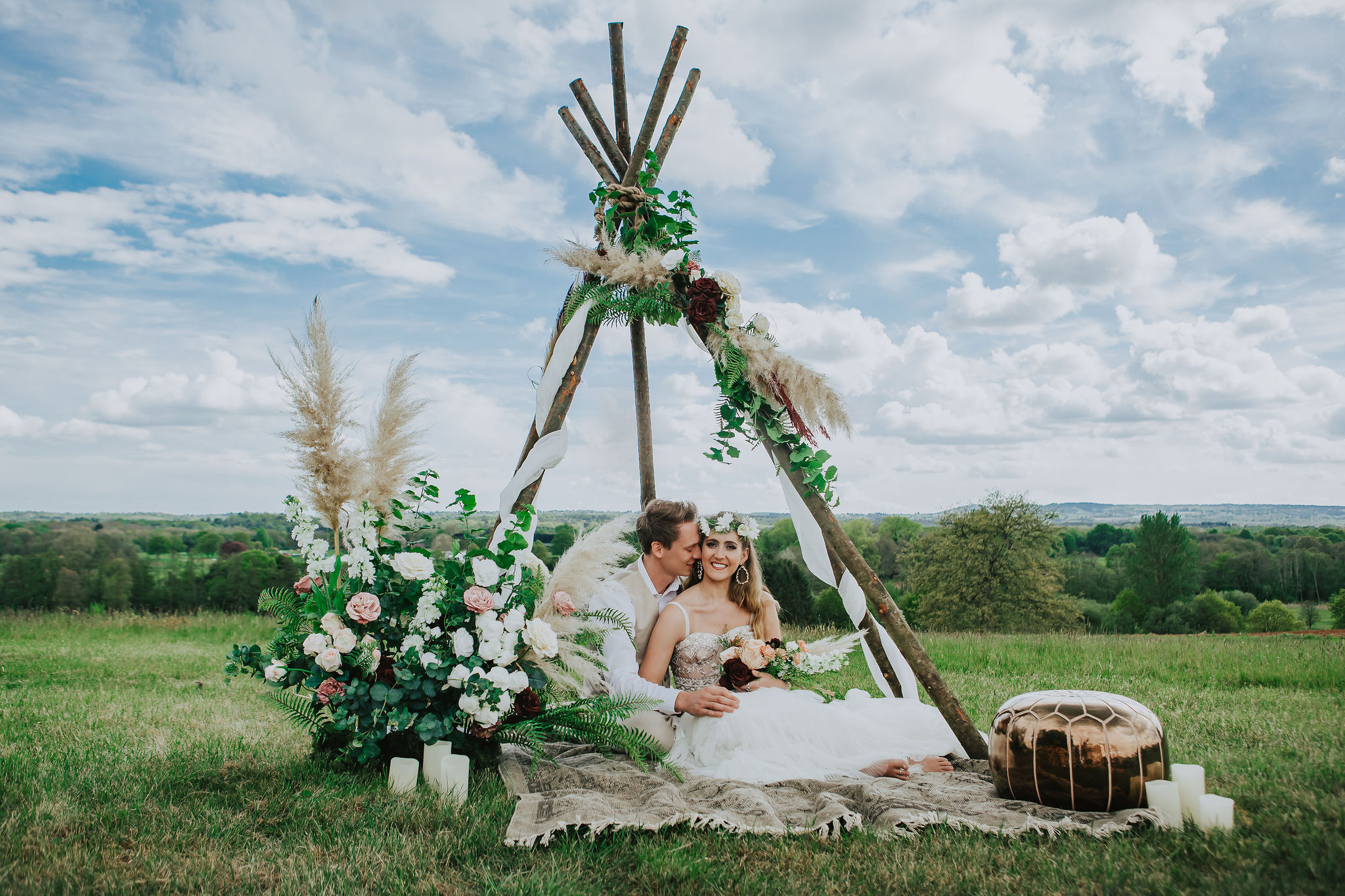 canvas-and-light-white-tipis-outdoor-ceremony-2.jpg