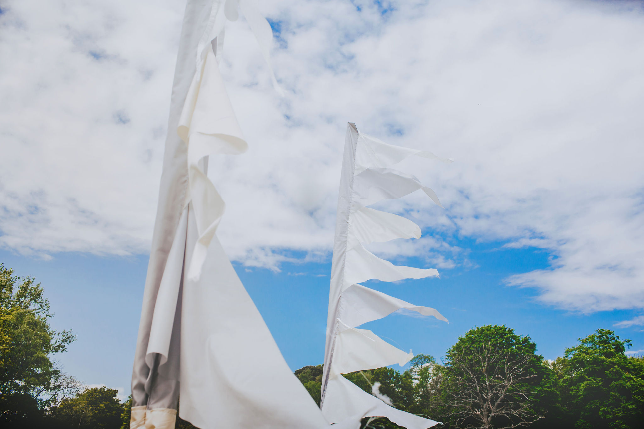 canvas-and-light-white-tipi-hire-festival-flags.jpg
