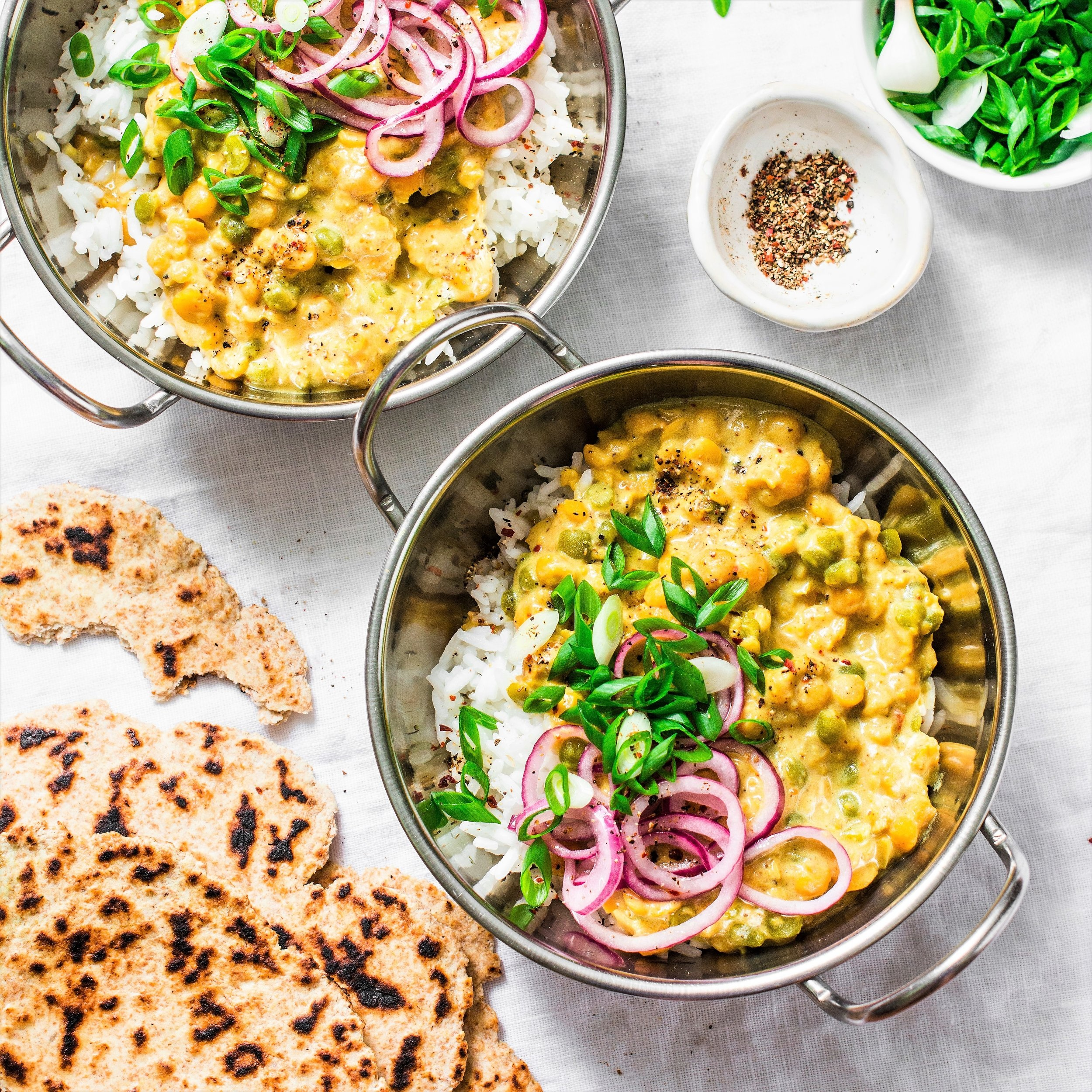 Indian+dhal+with+jasmine+rice%2C+marinated+red+onion%2C+scallion+and+whole+grain+flatbread+on+light+background%2C+top+view.+Flat+lay%2C+vegetarian+f.jpg