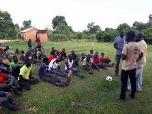 Addressing-young-men-in-Uganda-300x225.jpg